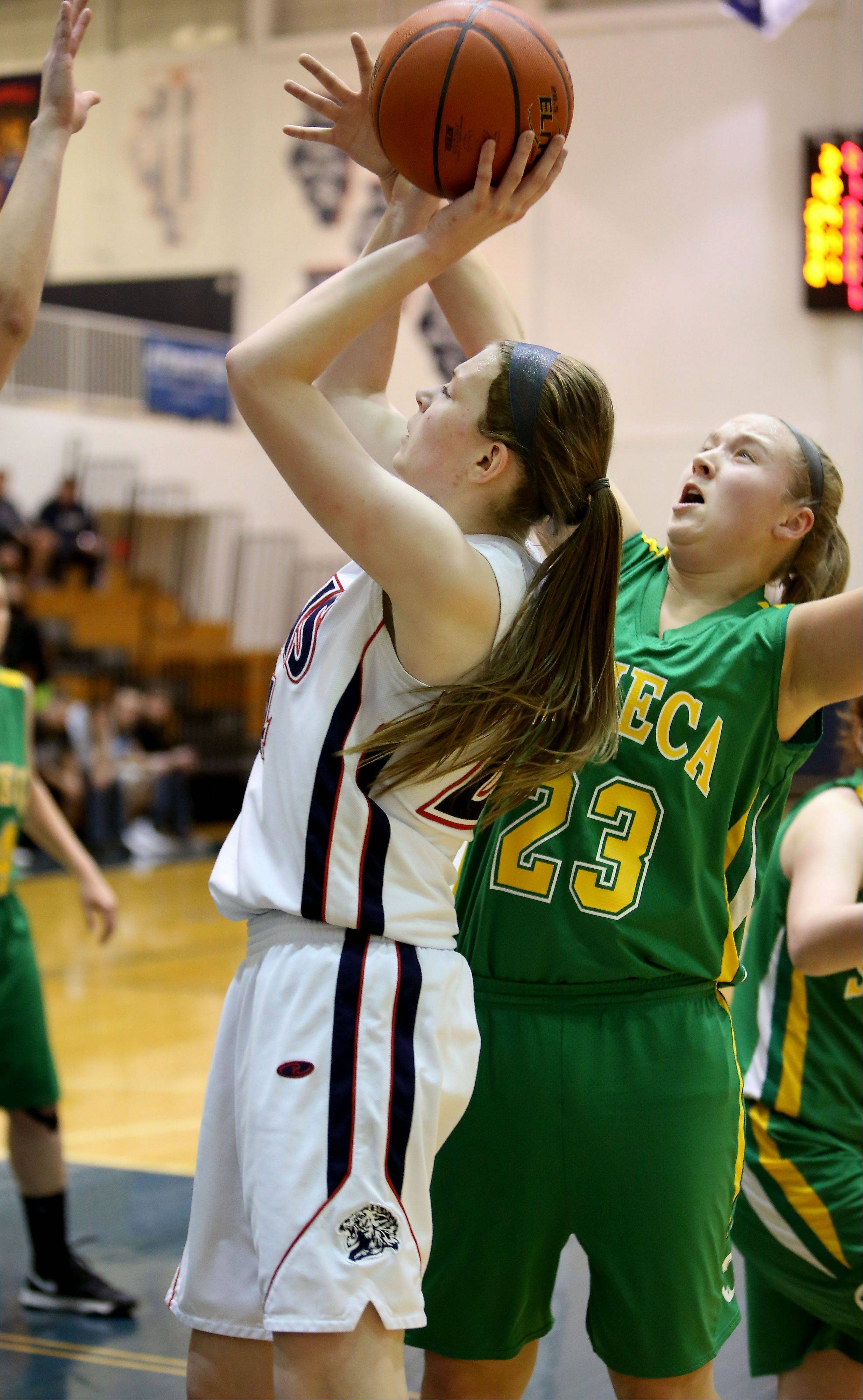 Lisle's Leah Reeves, left, shoots for two points as Seneca's Jacey Lamboley defends.