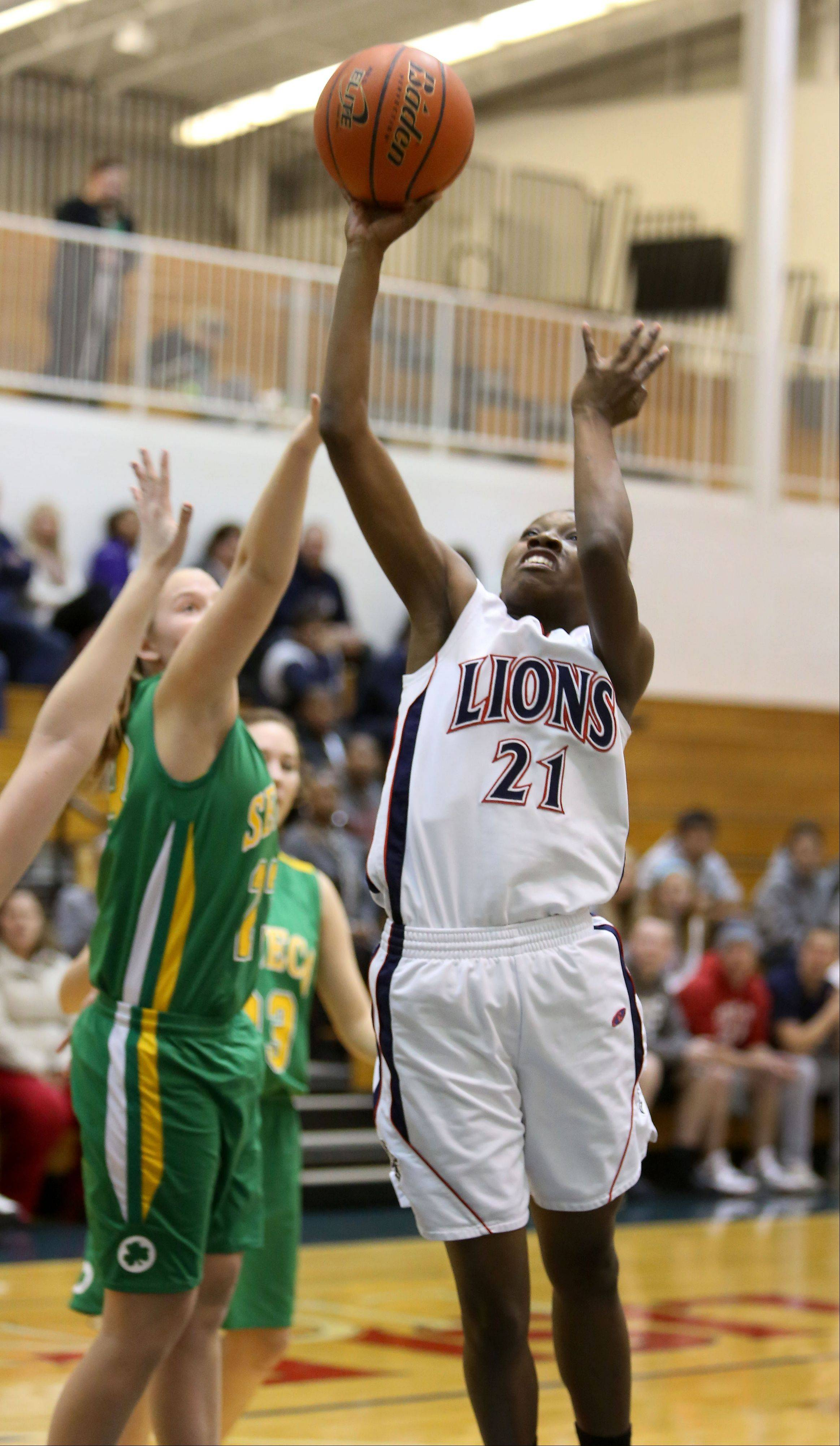 Lisle's Monifah Davis shoots the ball.