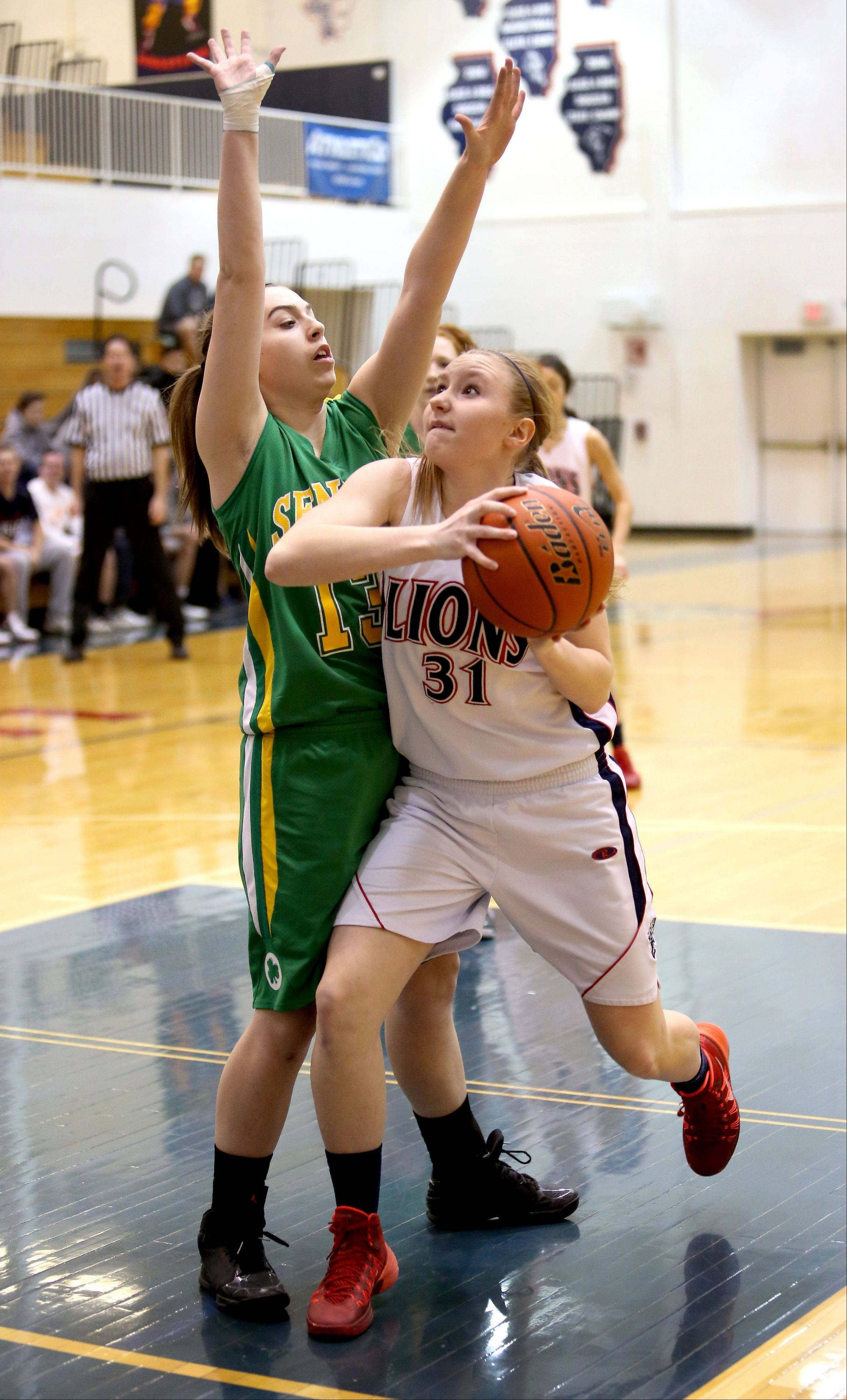 Lisle's Sarah Morgensen, right, looks to shoot as Seneca's Daniell Hauch defends.