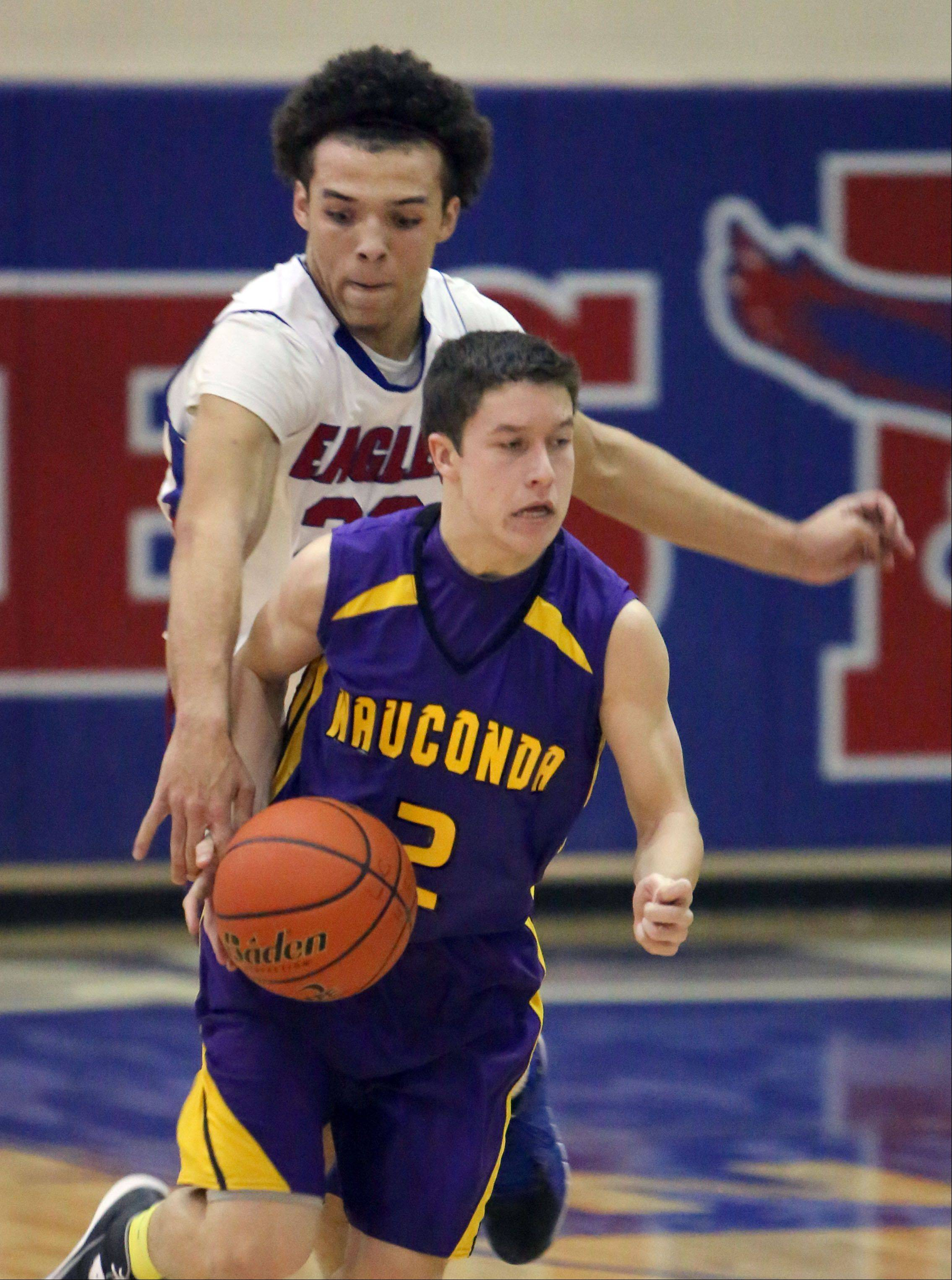 Lakes' Tramone Hudson, left, tries to pick the pocket of Wauconda's Brian Malisheski on Tuesday night at Lakes.
