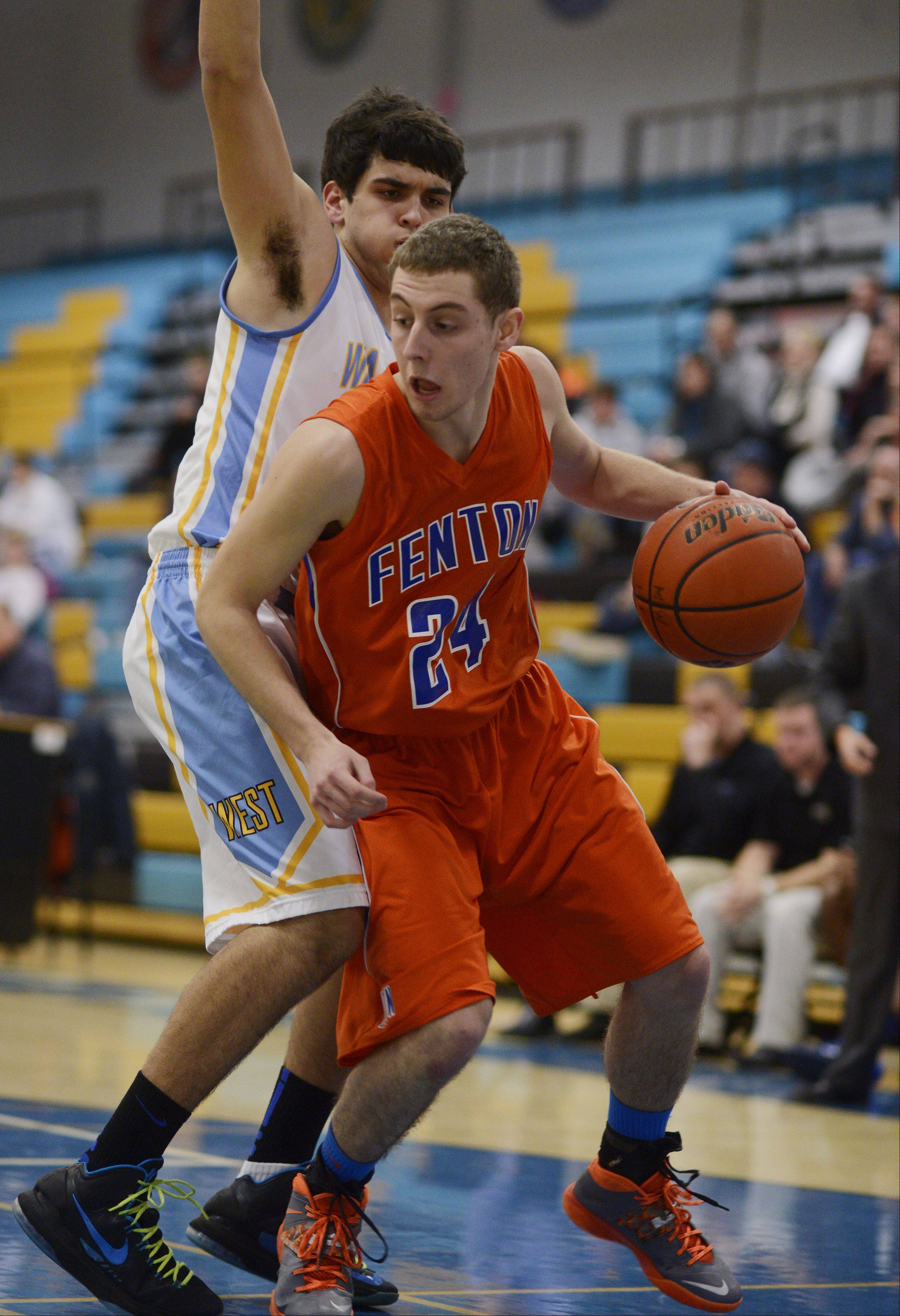 Fenton's Rob Kik, front, looks for room along the baseline against Maine West defender Matt Acevedo during Tuesday's game in Des Plaines.