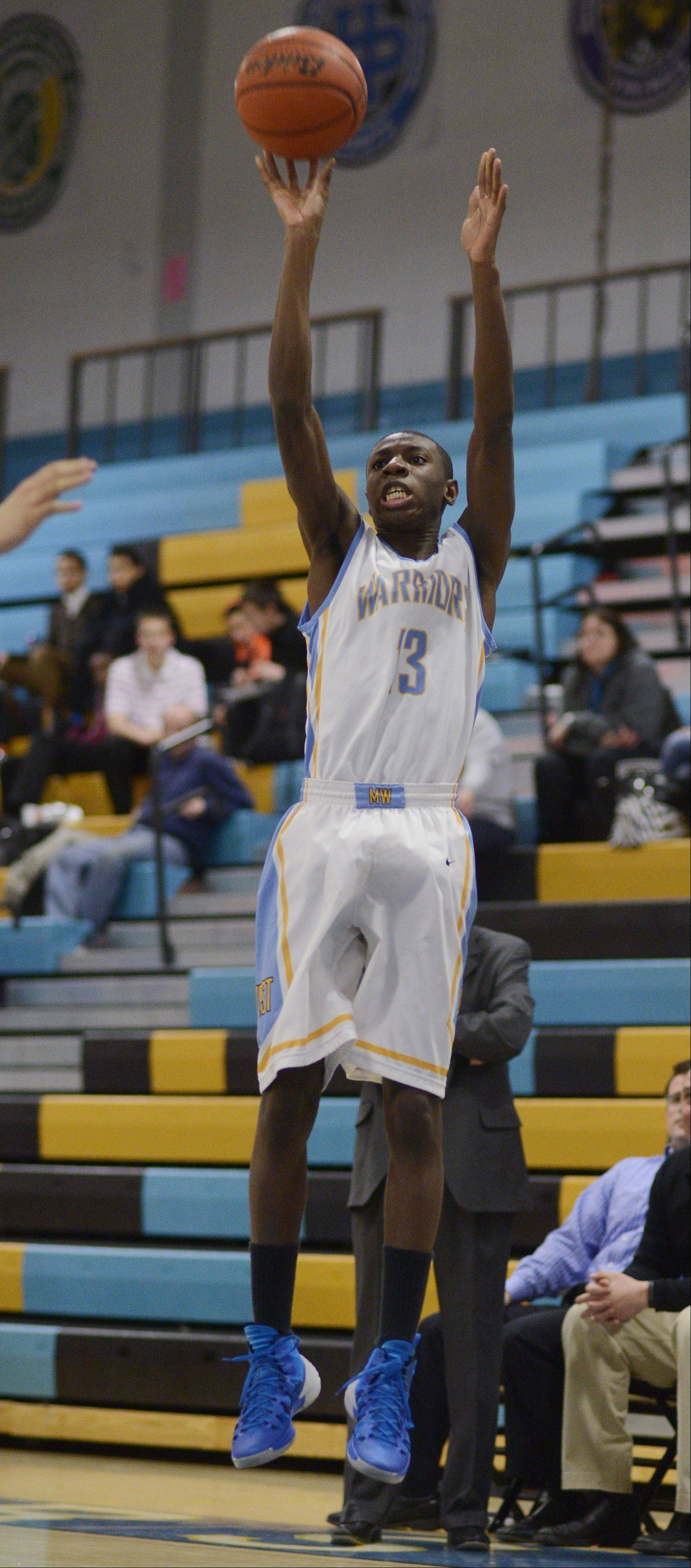 Maine West's Josh Redd shoots a 3-pointer during Tuesday's game against Fenton in Des Plaines.