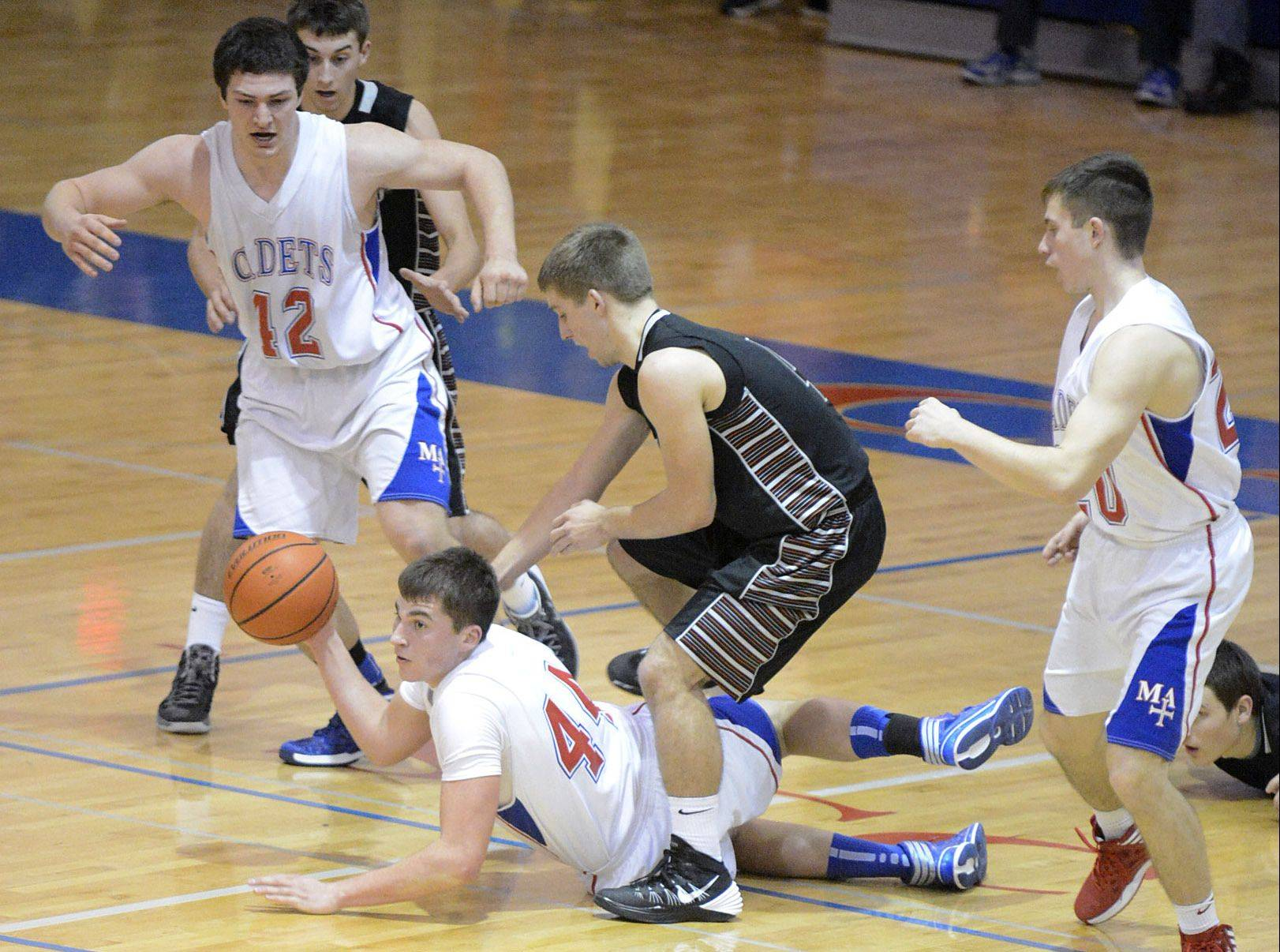 Marmion Academy's Danny Bicknell hustles to pass out of trouble against Drew David and Kaneland on Tuesday.