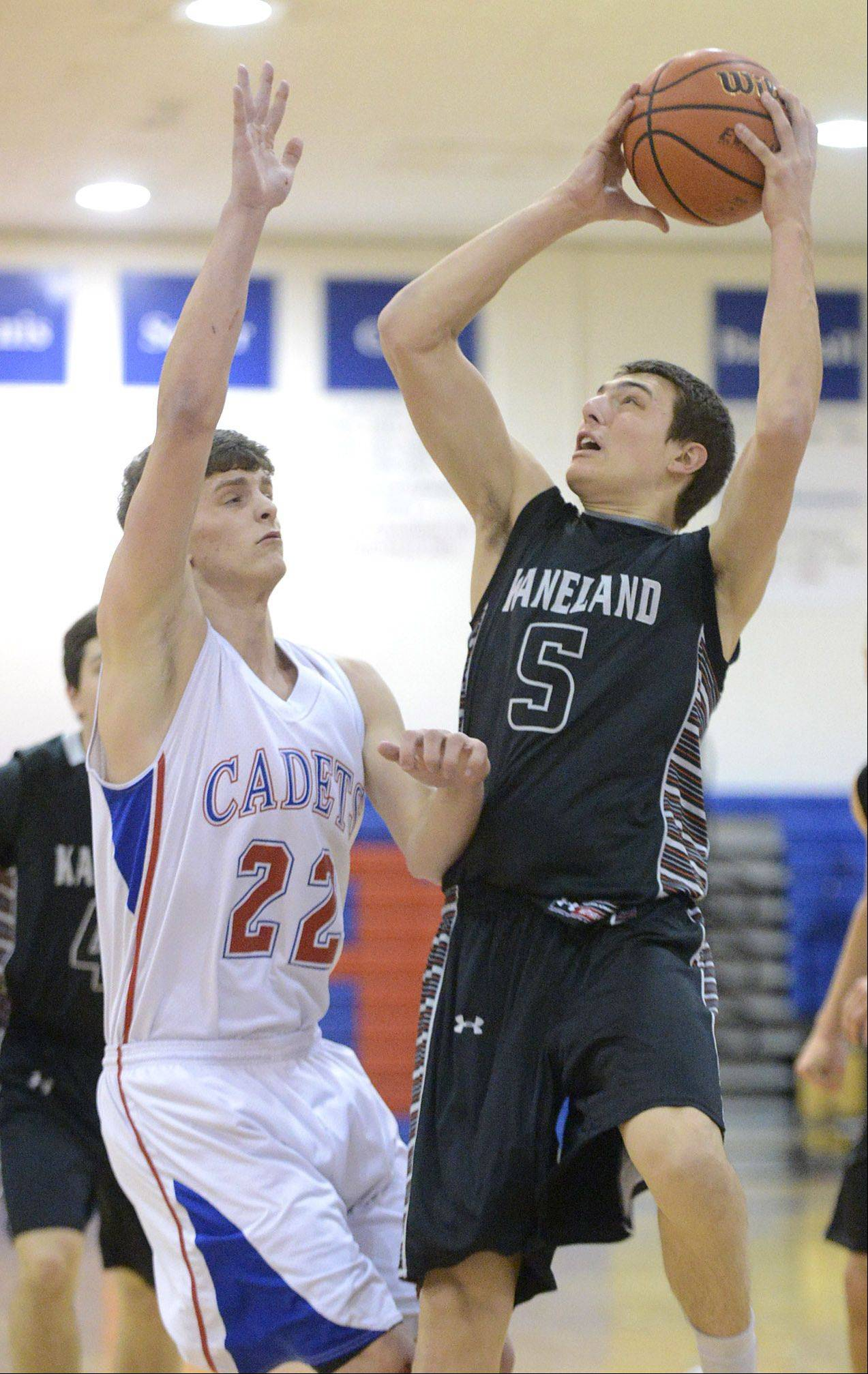 Kaneland's John Pruett shoots over a block by Marmion Academy's Jake Esp in the first quarter on Tuesday, January 14.