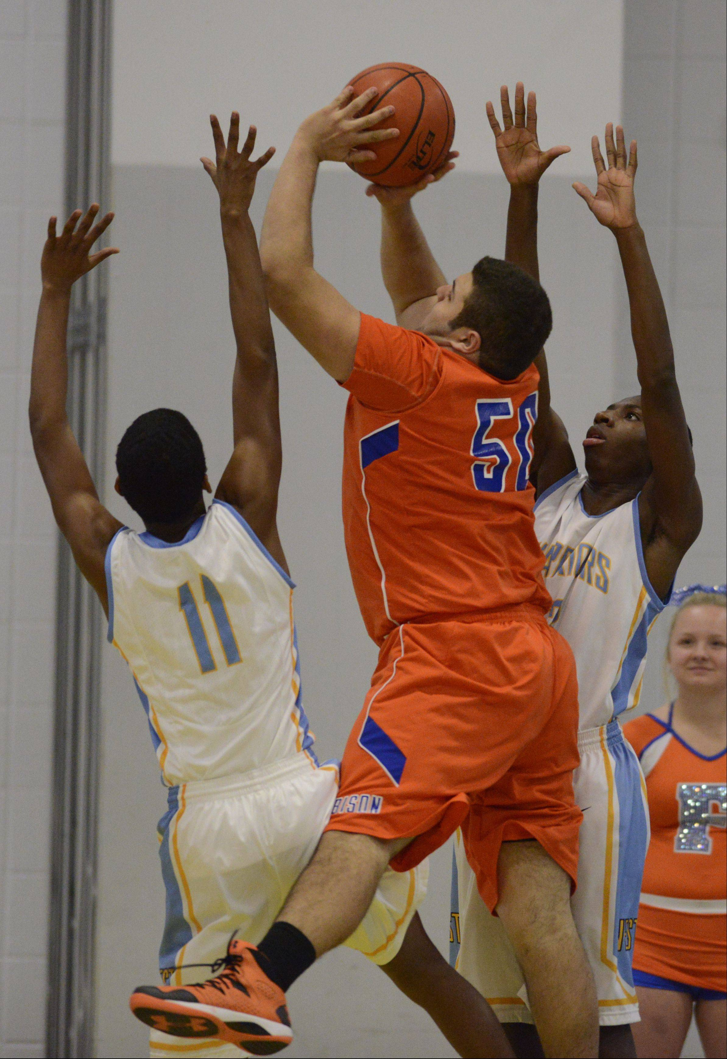 Photos from the Maine West vs. Fenton boys basketball game on Tuesday, January 14th, in Des Plaines.