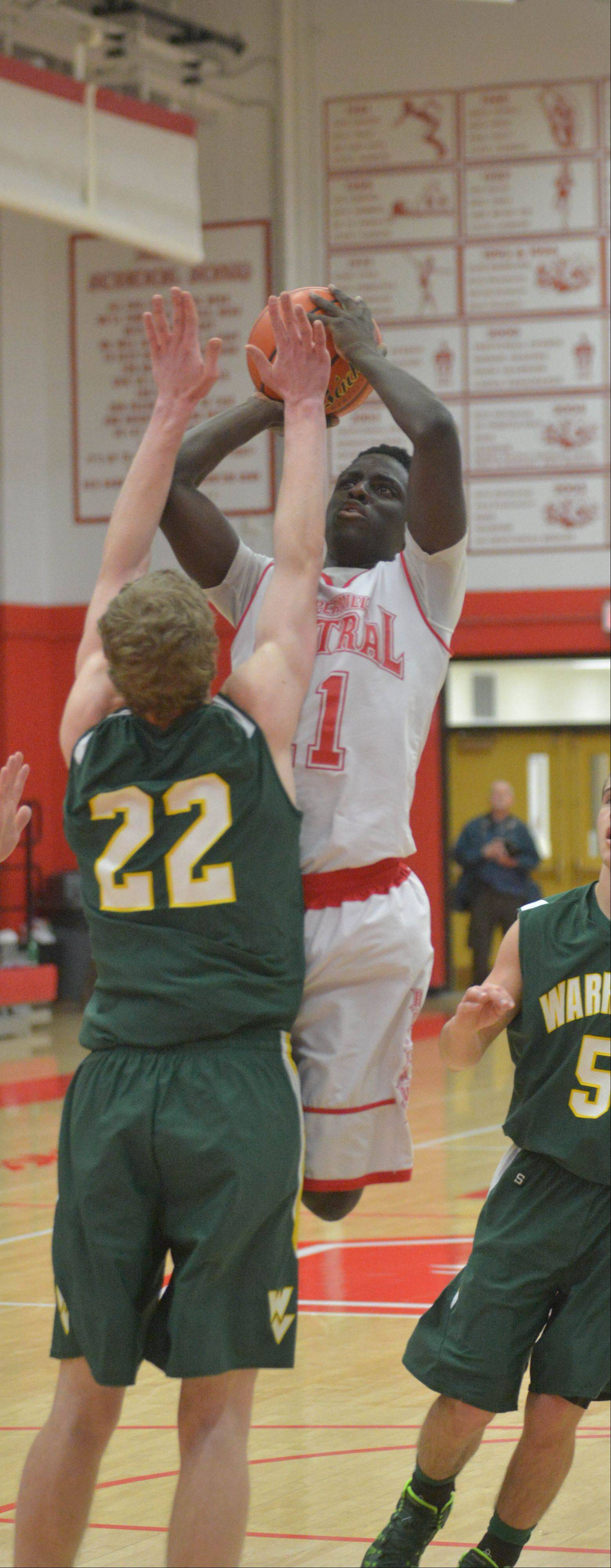 Jack Cordes of Waubonsie Valley pressures Manny Rugamba of Naperville Central.