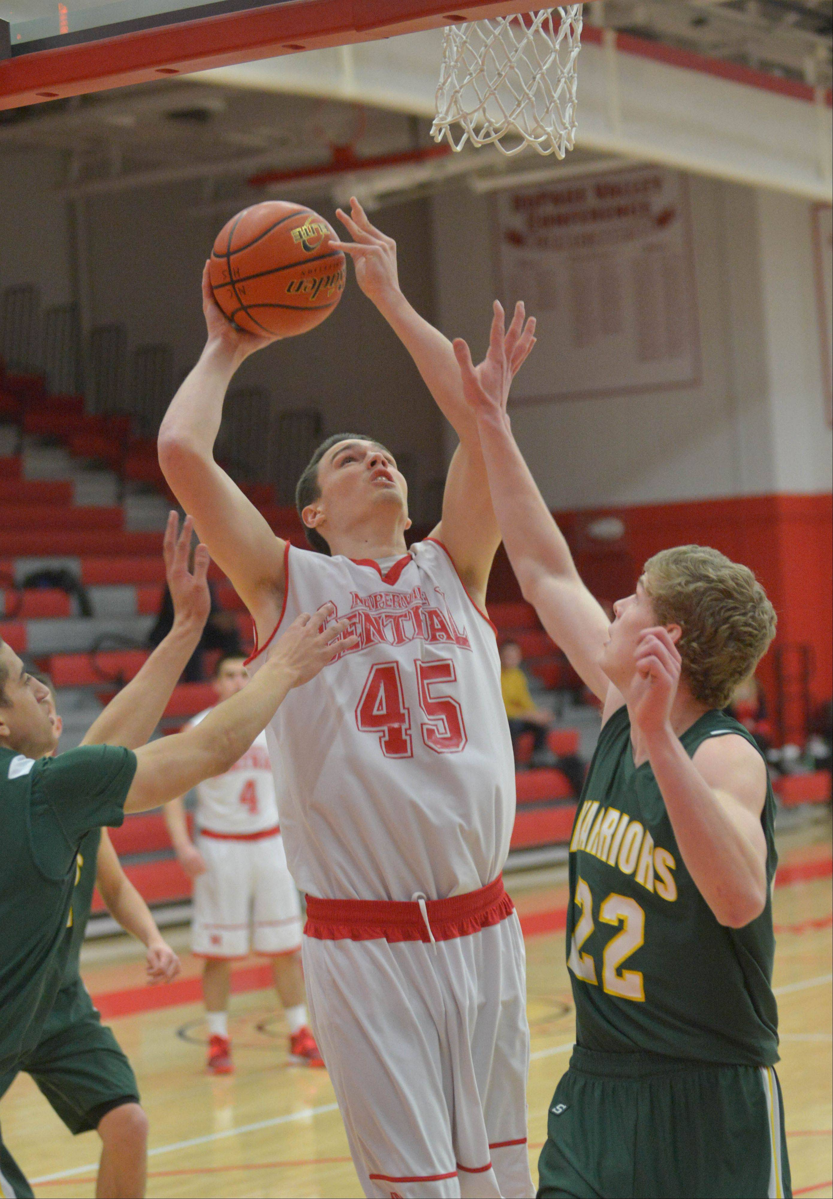 Nick Czarnowski of Naperville Central takes a shot over Jack Cordes of Waubonsie Valley.