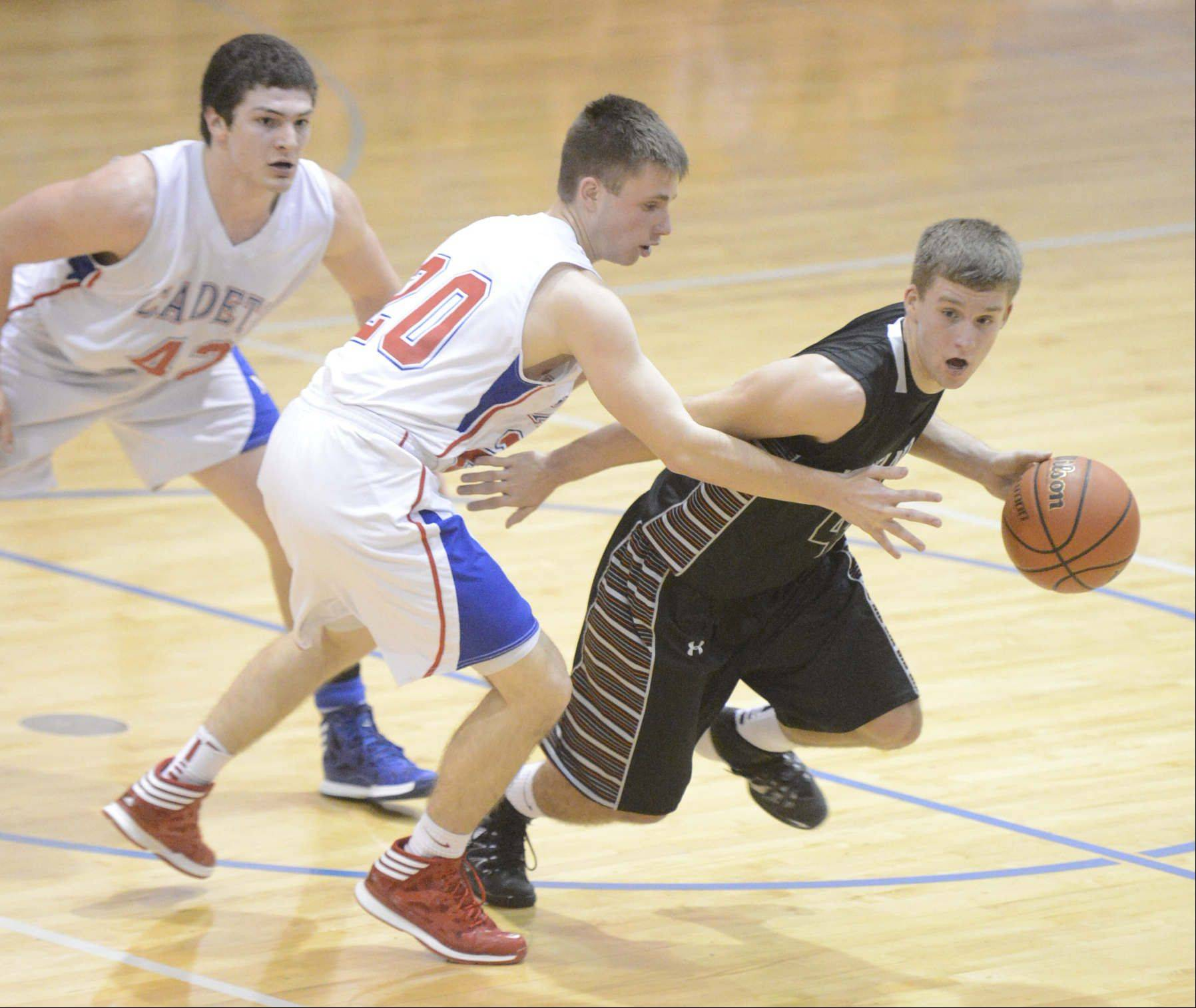 Images from the Kaneland vs. Marmion Academy boys basketball game Tuesday, January 14, 2014.