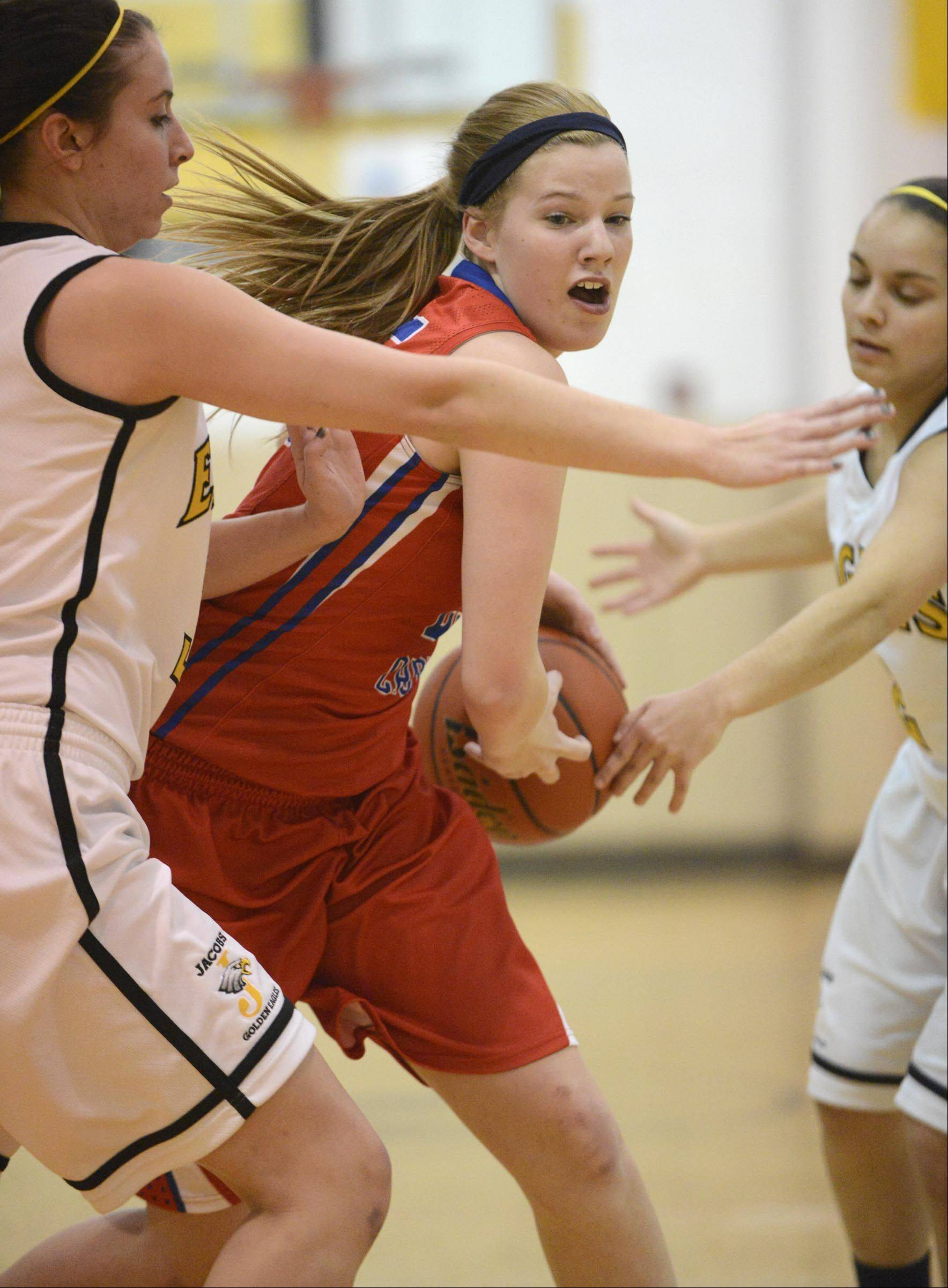 Jacobs' Jennifer Barnec and Talia Surges, right, surround Dundee-Crown's Allison Michalski .