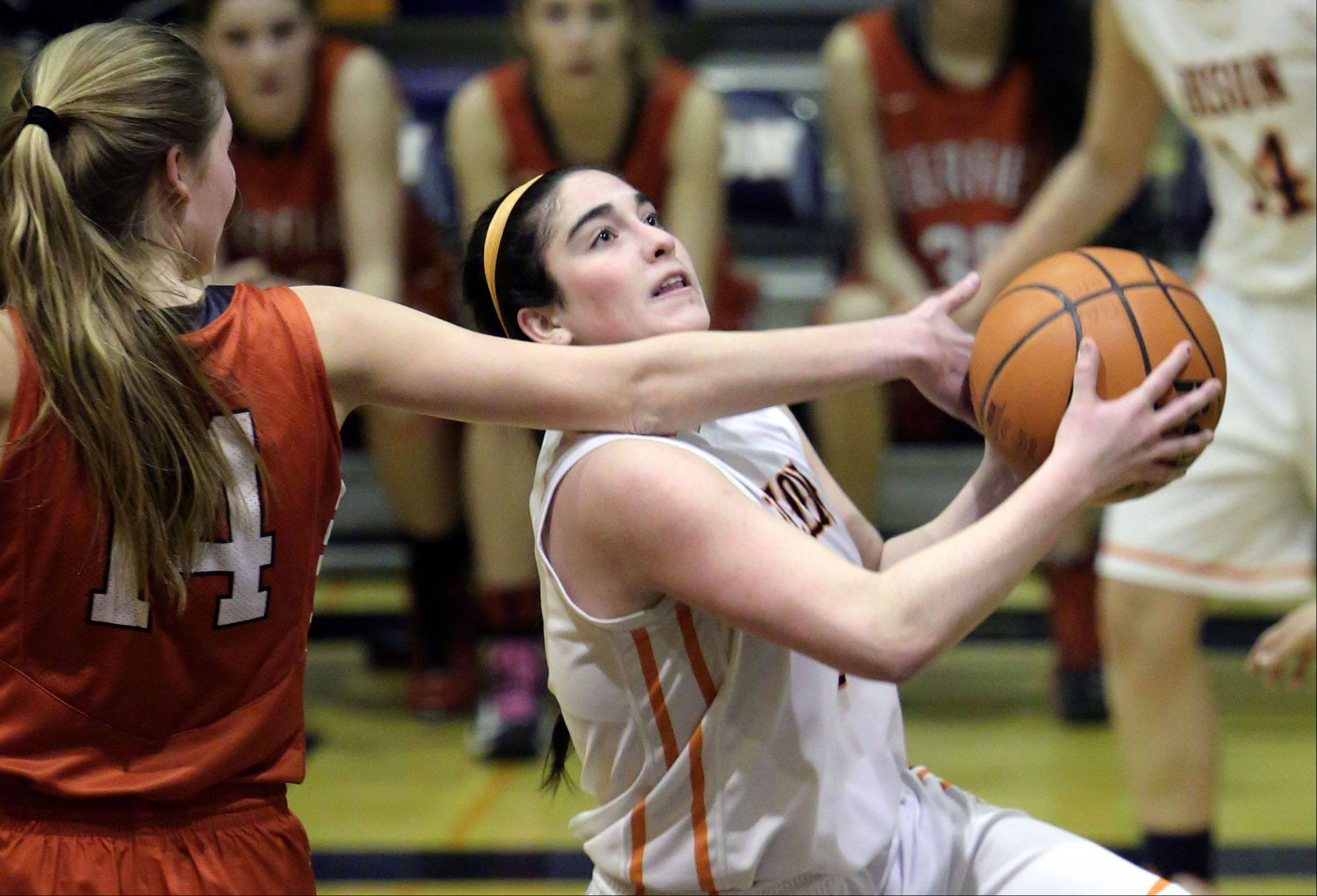 Buffalo Grove's Julie Jambrone, right, powers past Deerfield's Monica Fishbein on Monday night in Buffalo Grove.