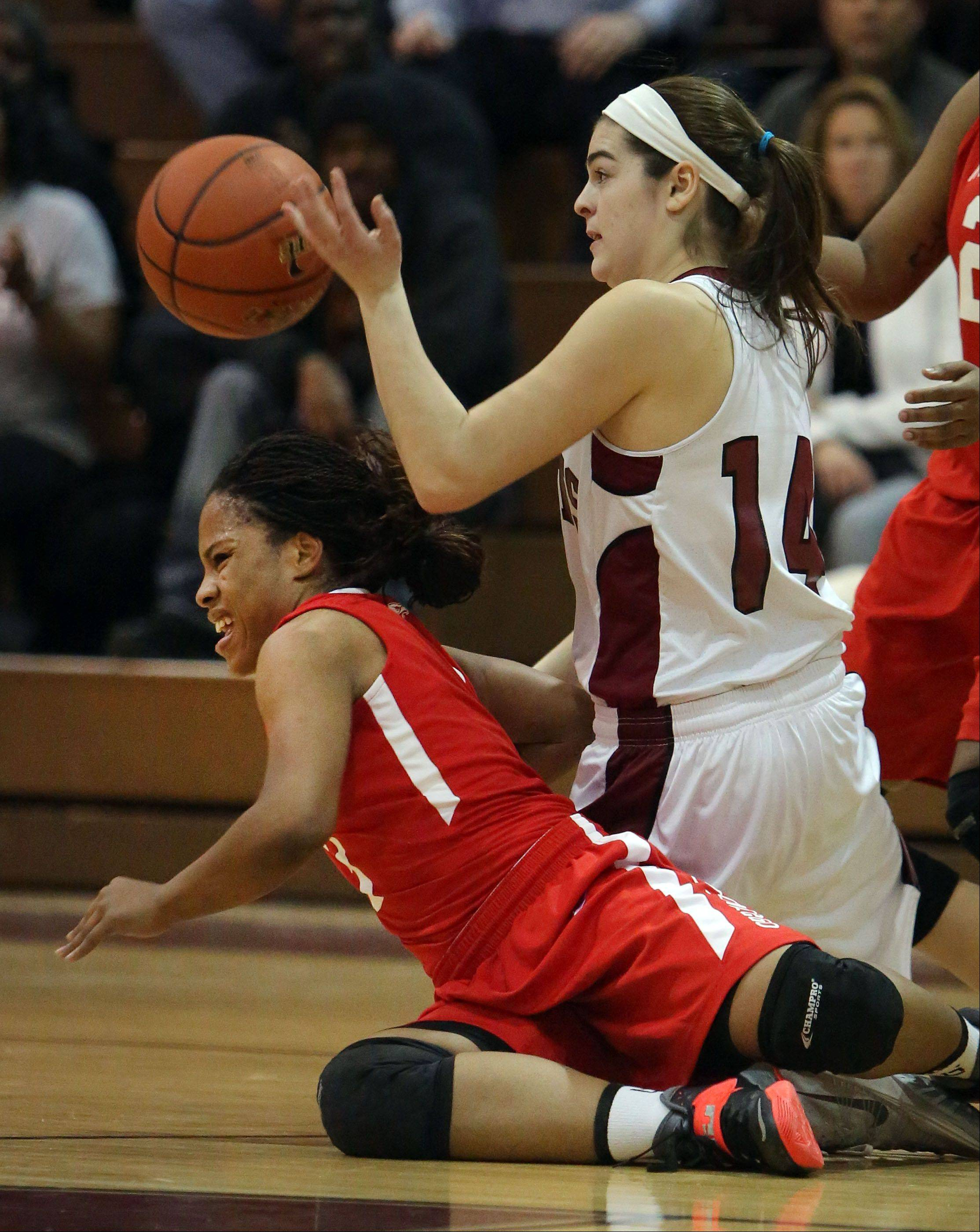 Antioch's Amy Reiser, right, and North Chicago's Alexis Means scramble for a loose ball on Wednesday night at Antioch.