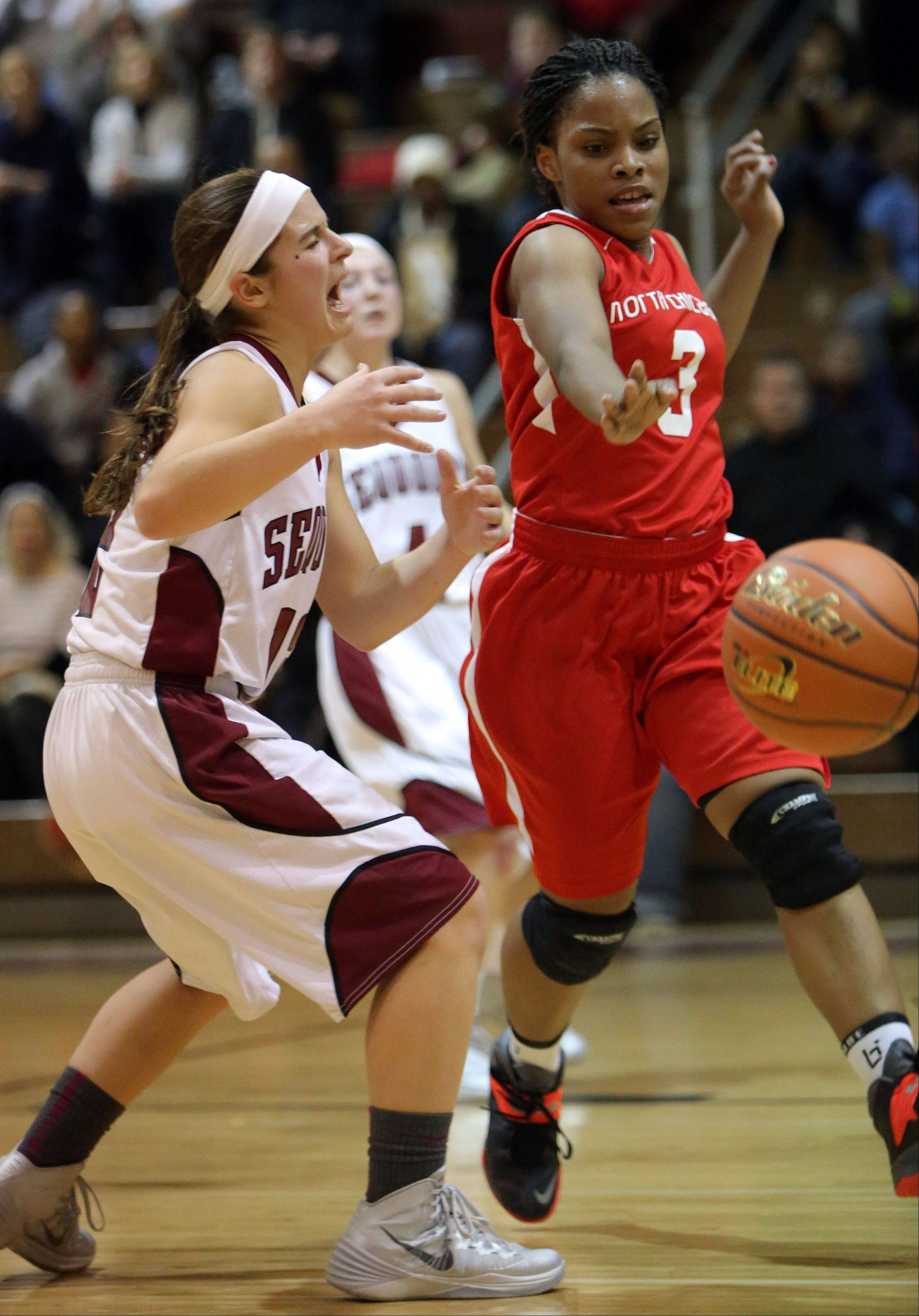 Antioch's Ashley Reiser, left, has the ball stripped by North Chicago's Alexis Means on Wednesday night at Antioch.