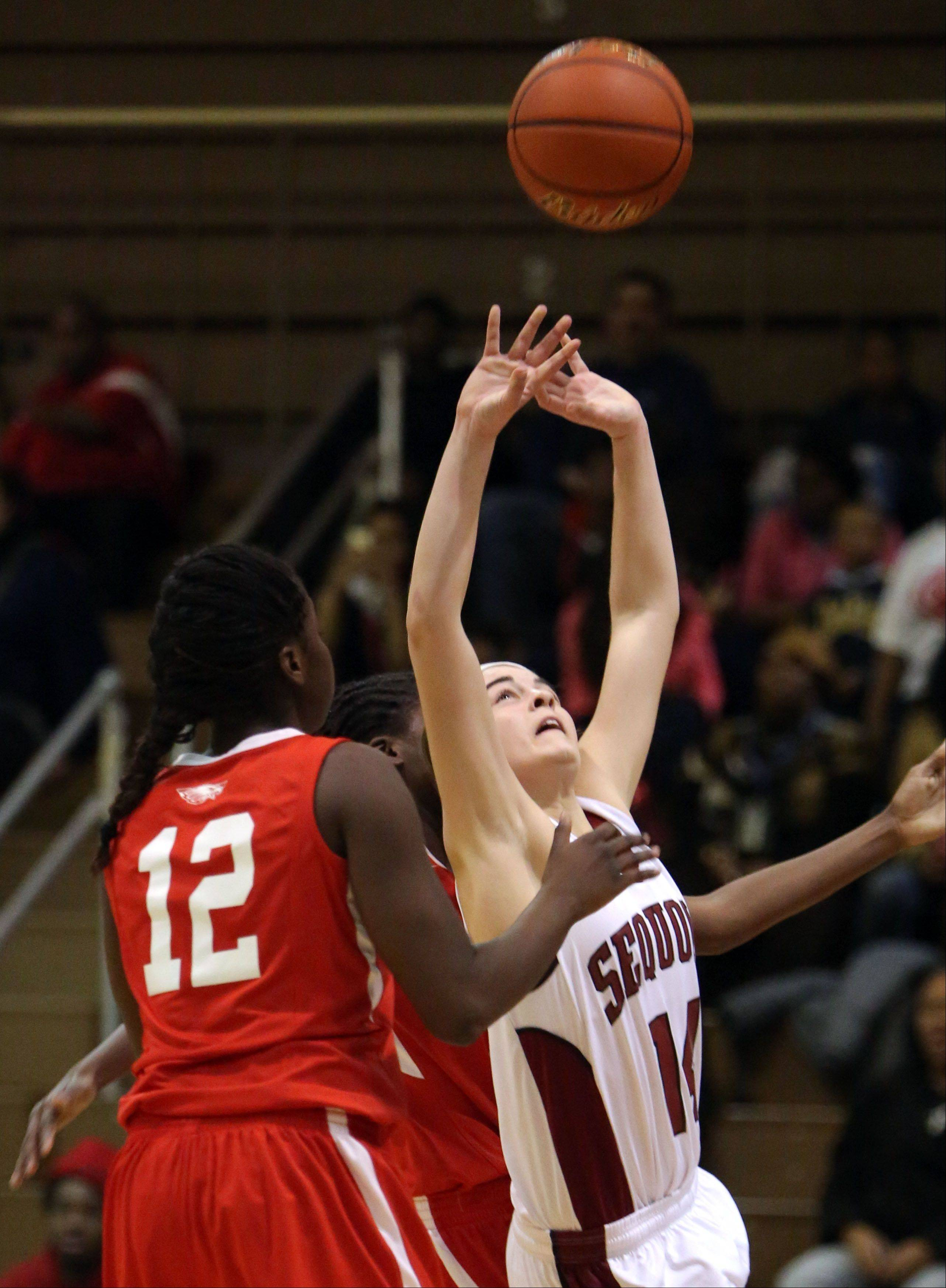 Antioch's Amy Reiser, right, shoots over North Chicago's Kylah Collins.