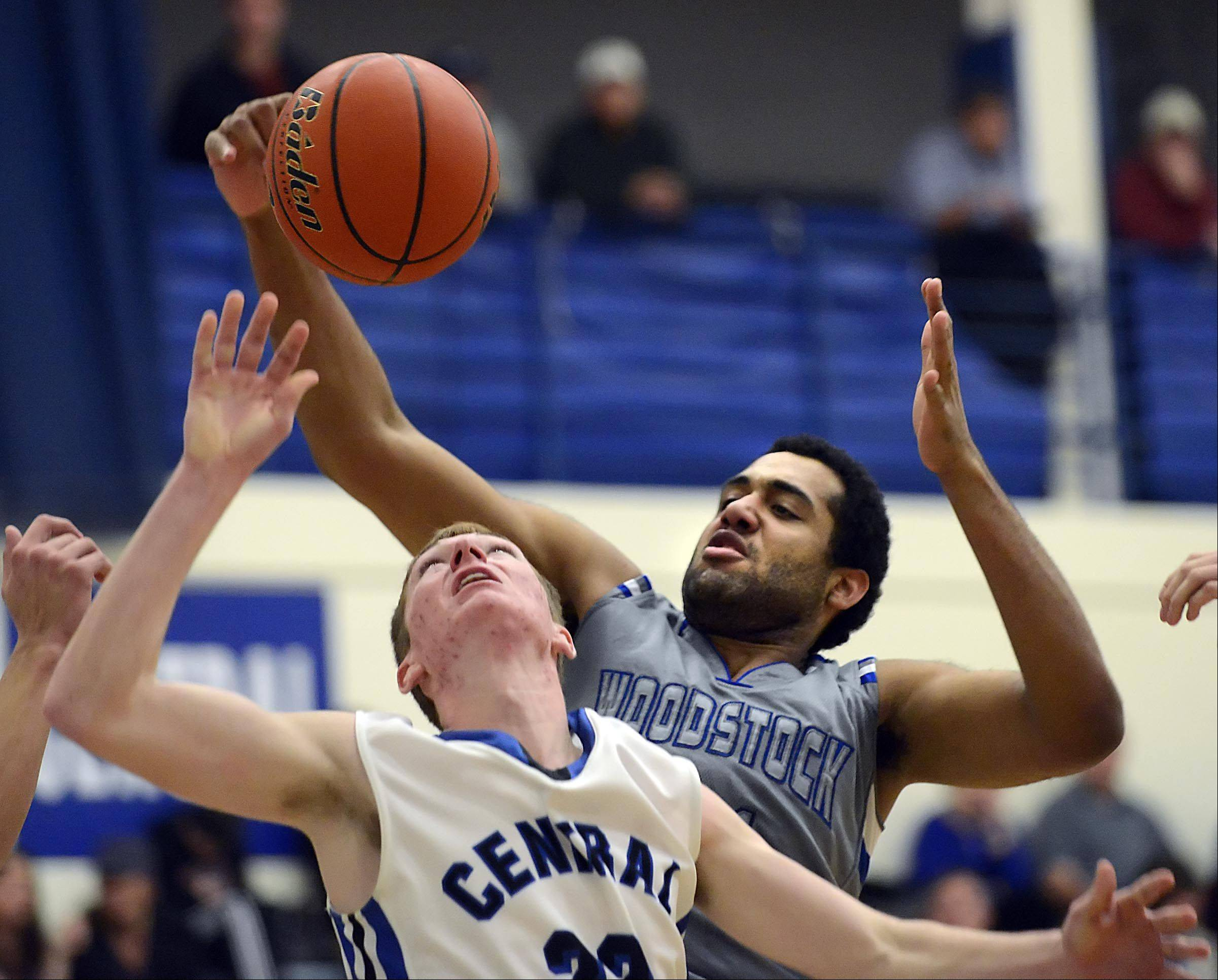 Burlington Central's Sean Fitzgerald and Woodstock's Damian Stoneking compete for a rebound.
