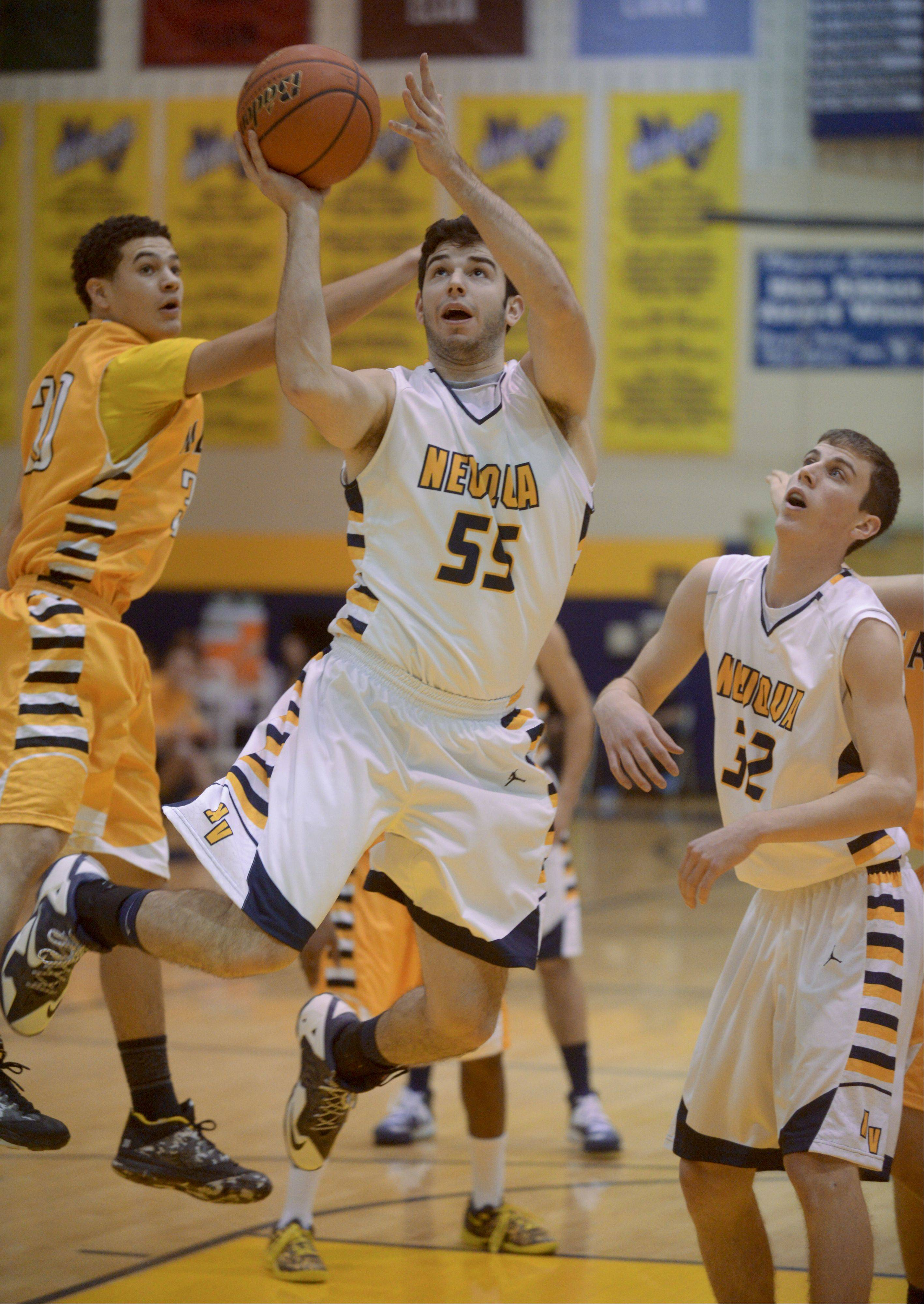 Mark Black/mblack@dailyherald.comZach Incaudo of Neuqua Valley lays up for a shot against Metea Valley during boys basketball.