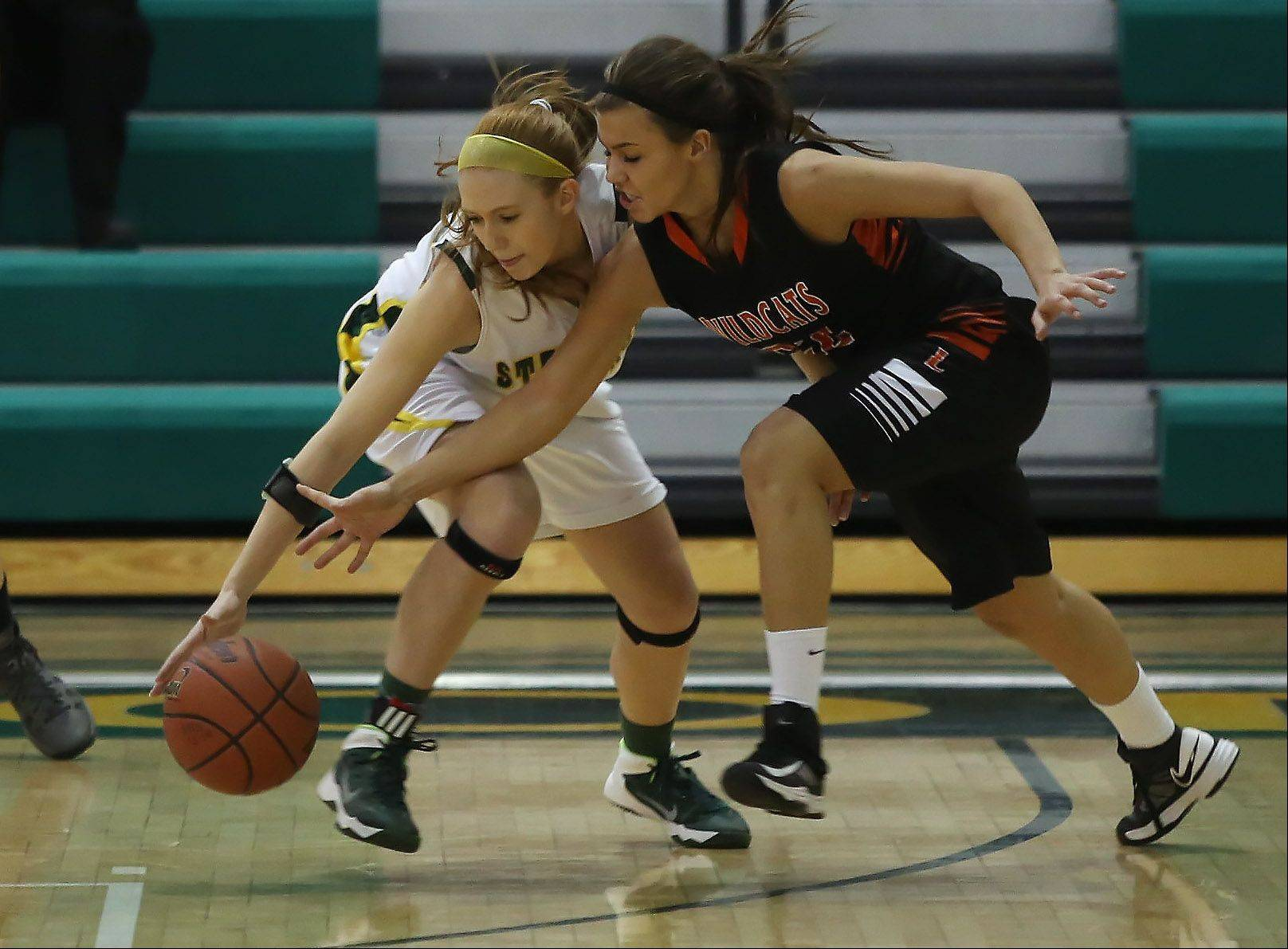 Stevenson guard Jessica Burke, left, steals the ball away from Libertyville guard Mary Wilterdink .