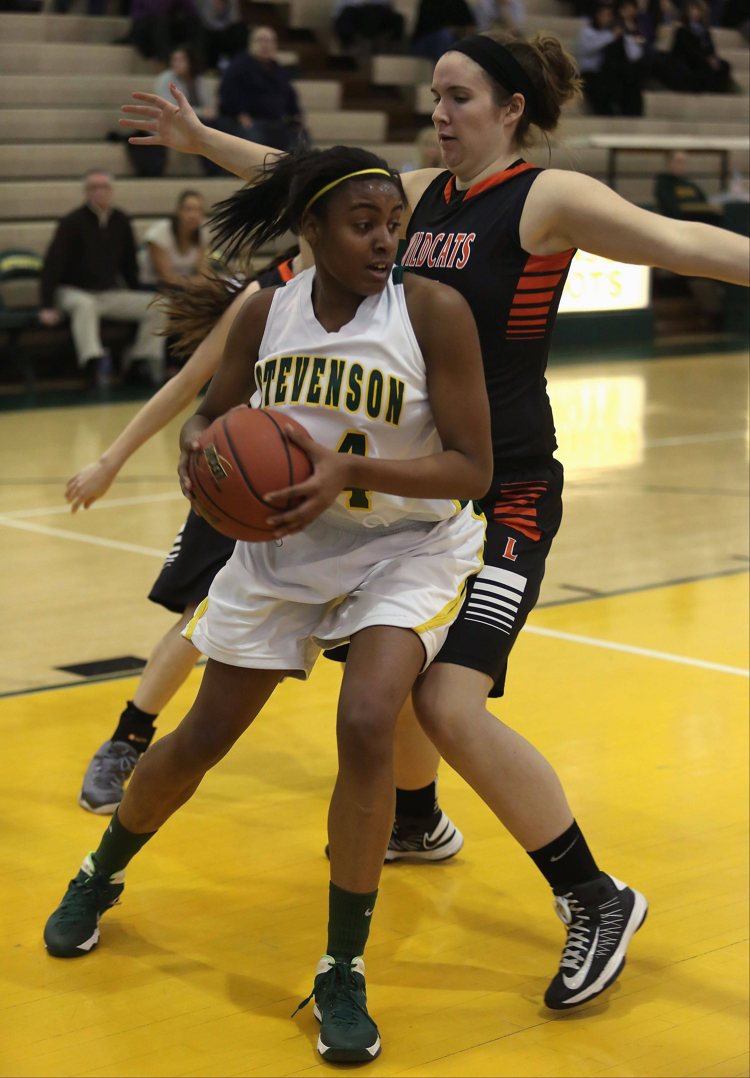 Stevenson forward Taylor Buford heads downcourt after taking a rebound away from Libertyville center Becky Deichl.