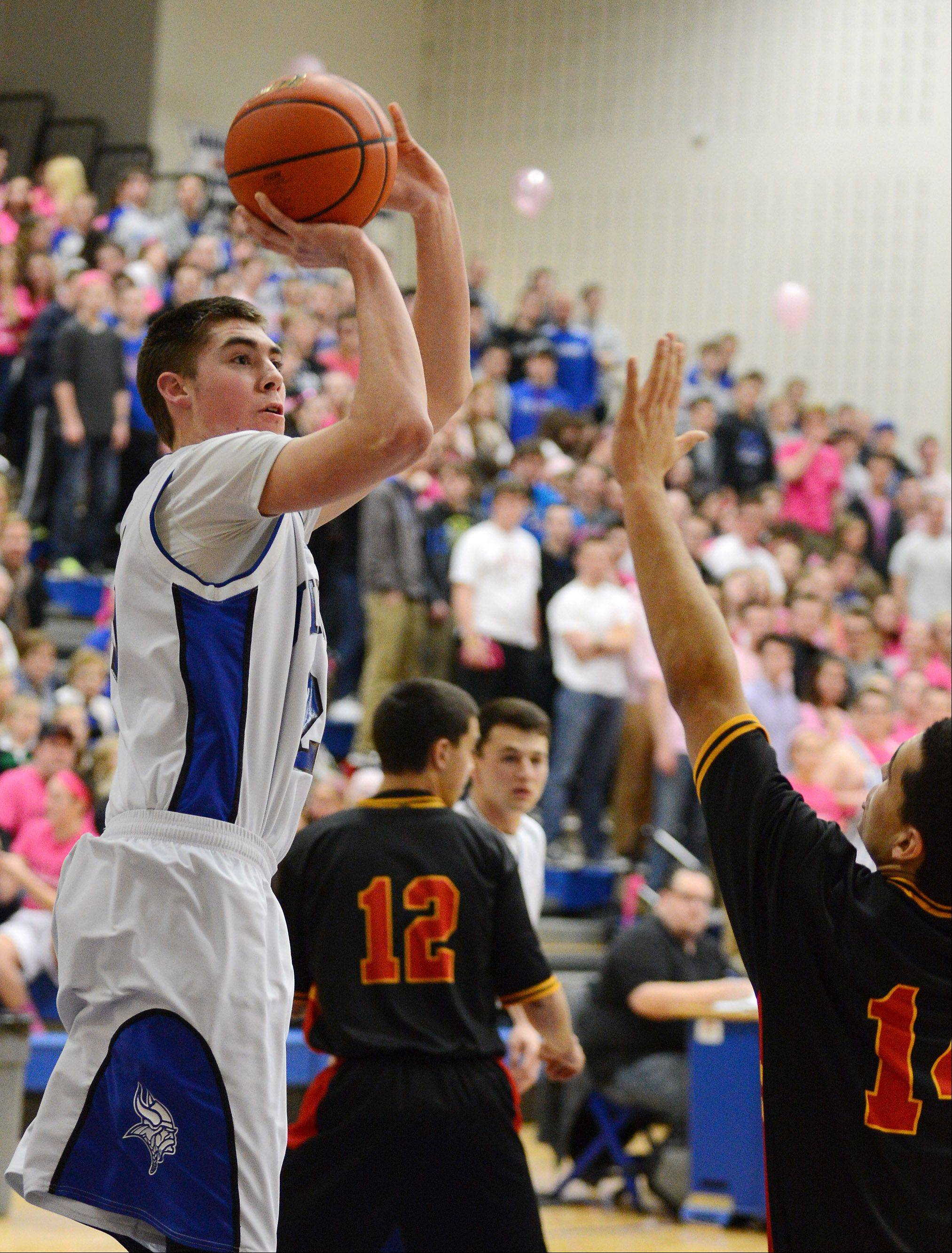 Geneva's Nate Navigato puts up a shot over Batavia's Micah Coffey during Friday's game in Geneva.
