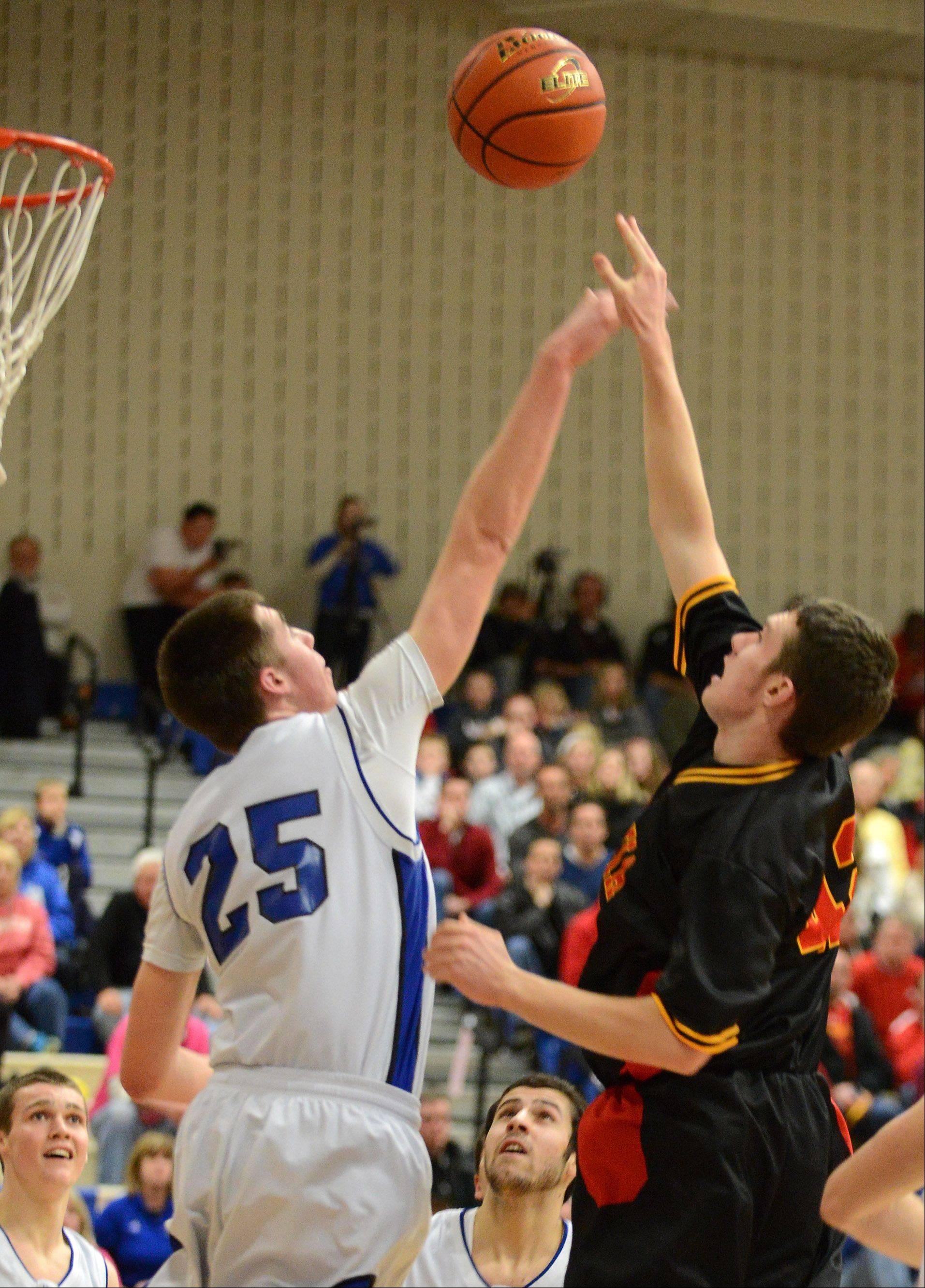 Batavia's Ryan Olson (42) puts up a shot over Nate Navigato of Geenva during Friday's game in Geneva.