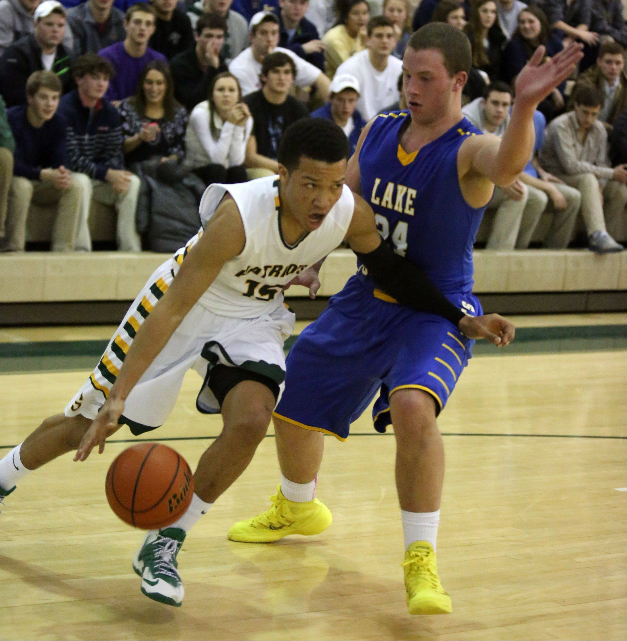 Stevenson forward Jalen Brunson turns the corner on Lake Forest defender Cal Miller at Stevenson on Friday.