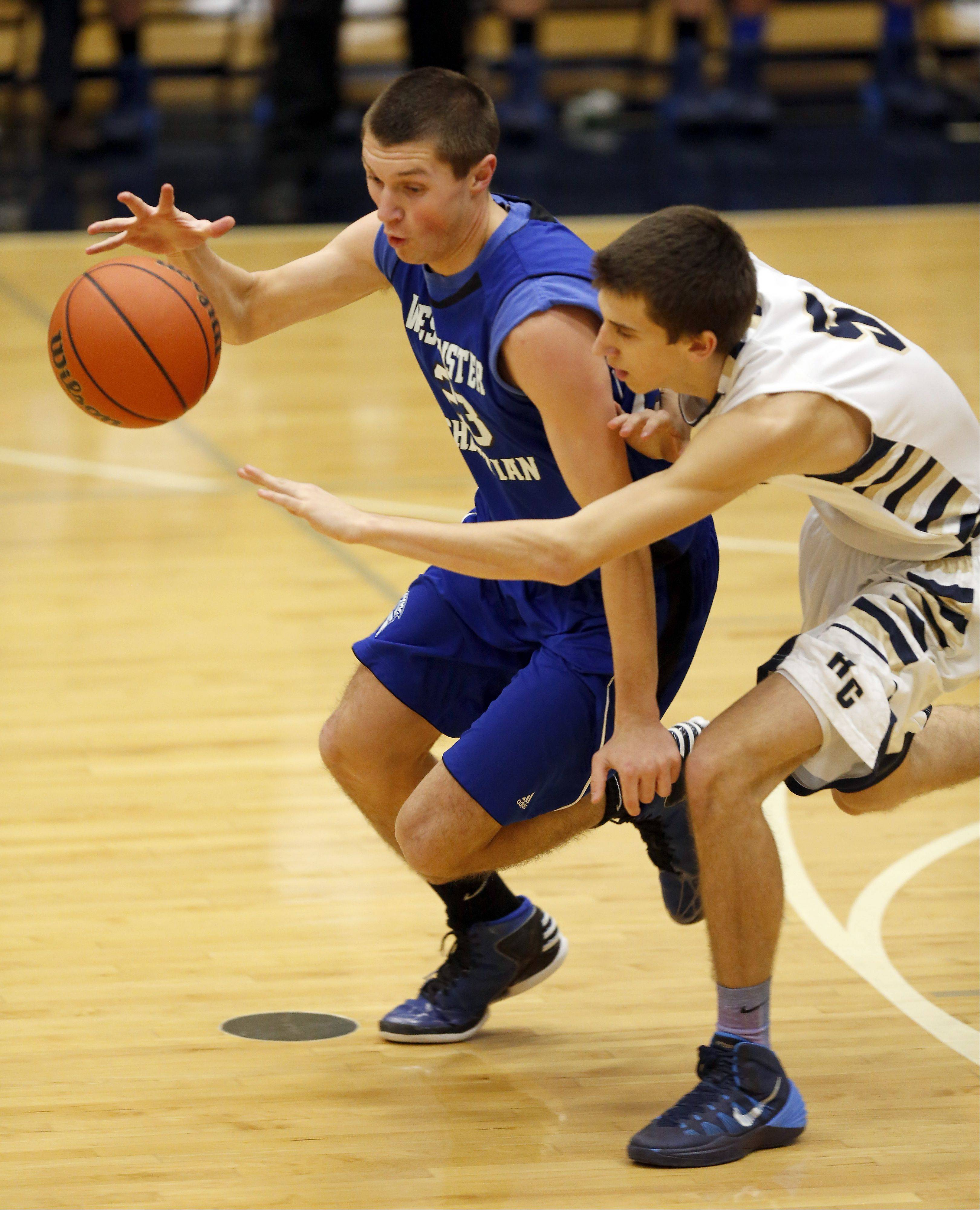 Westminster Christian's Robert Kleczynski works past Harvest Christian's Brett Cramer Friday in Elgin.