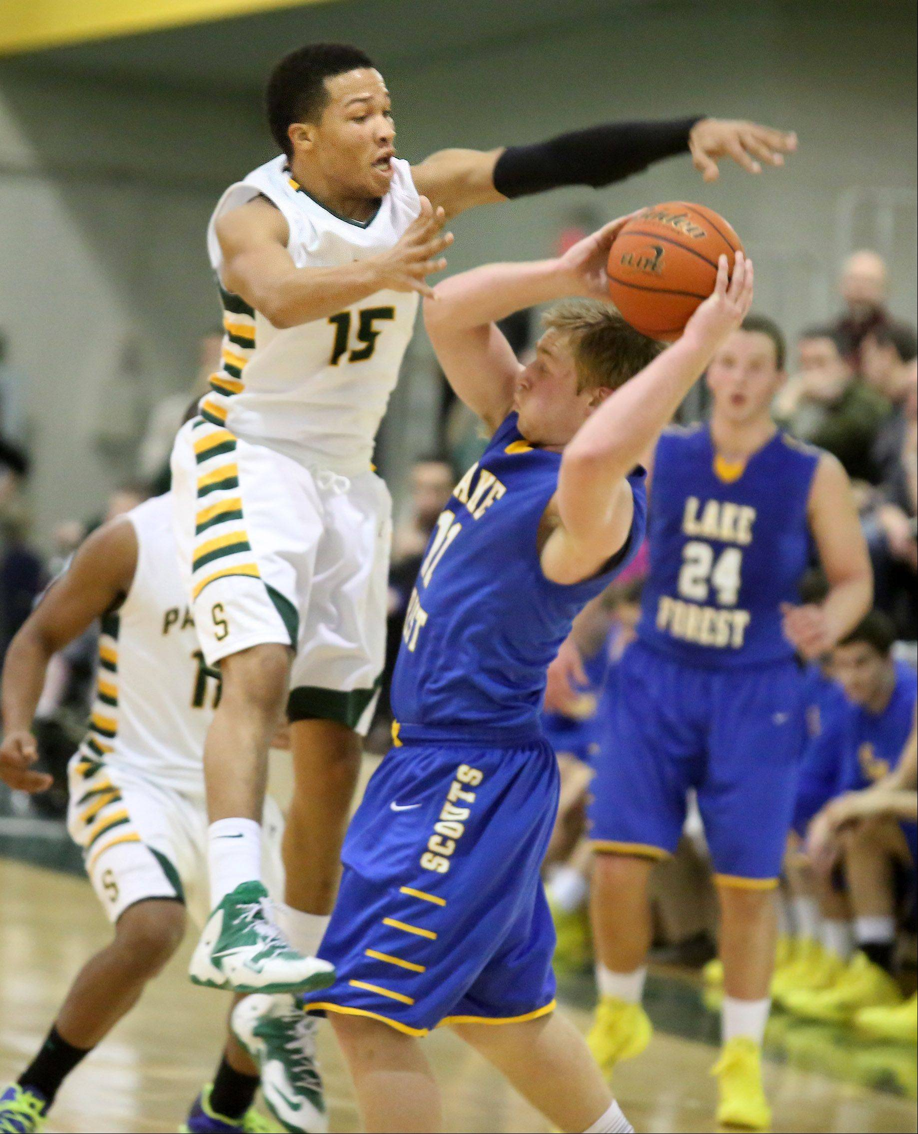 Stevenson guard Jalen Brunson leaps to stop Lake Forest guard Jack Traynor from passing the ball at Stevenson on Friday in Lincolnshire.