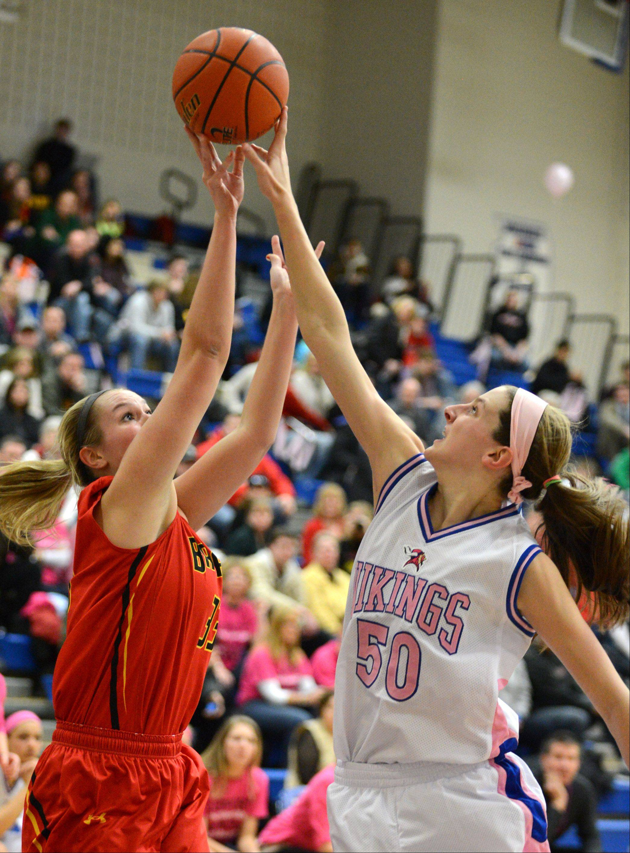 Geneva's Grace Loberg blocks a shot by Batavia's Erin Bayram (33) during Friday's game in Geneva.