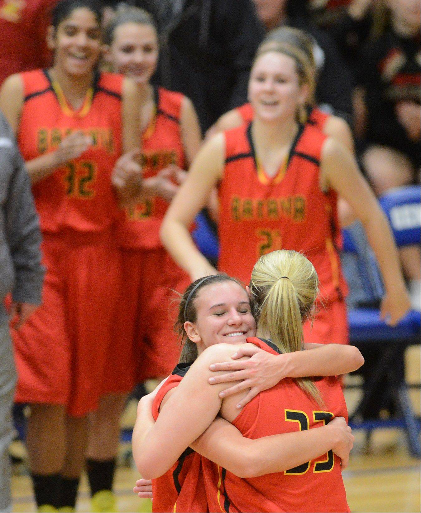 Batavia's Liza Fruendt (5) hugs teammate Erin Bayram (33) after their win against rival Geneva Friday night in Geneva.