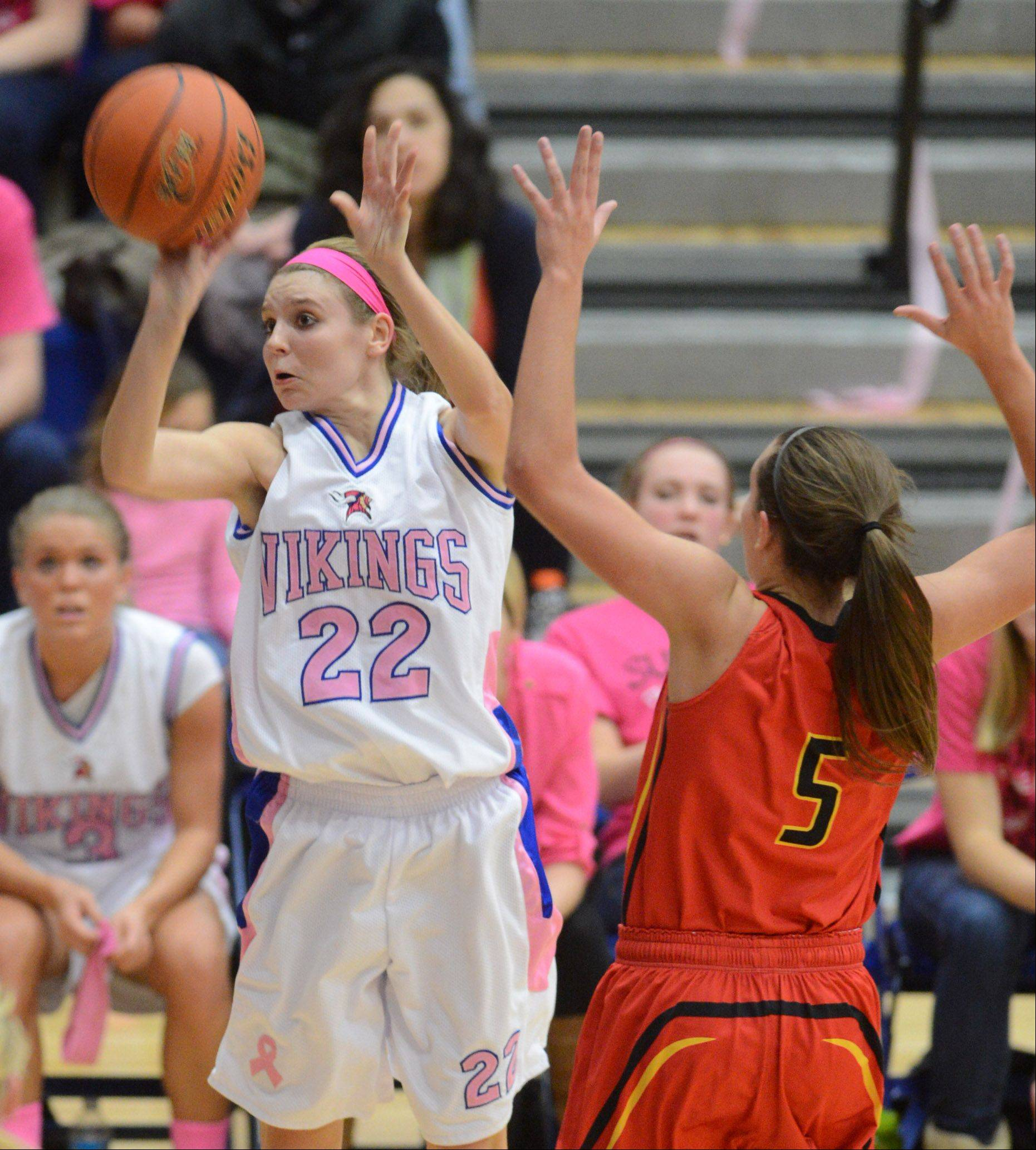 Geneva's Morgan Seberger (22) puts up a 3-pointer during Friday's game in Geneva.