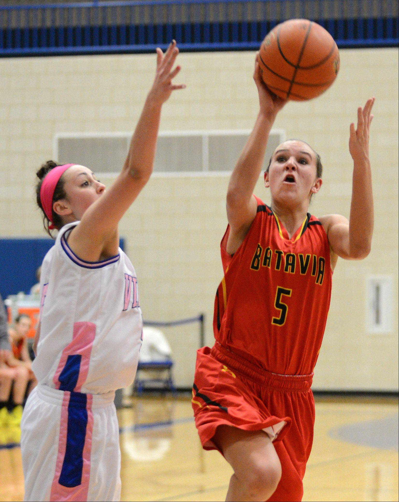 Batavia's Liza Fruendt (5) drives and scores during Friday's game in Geneva.