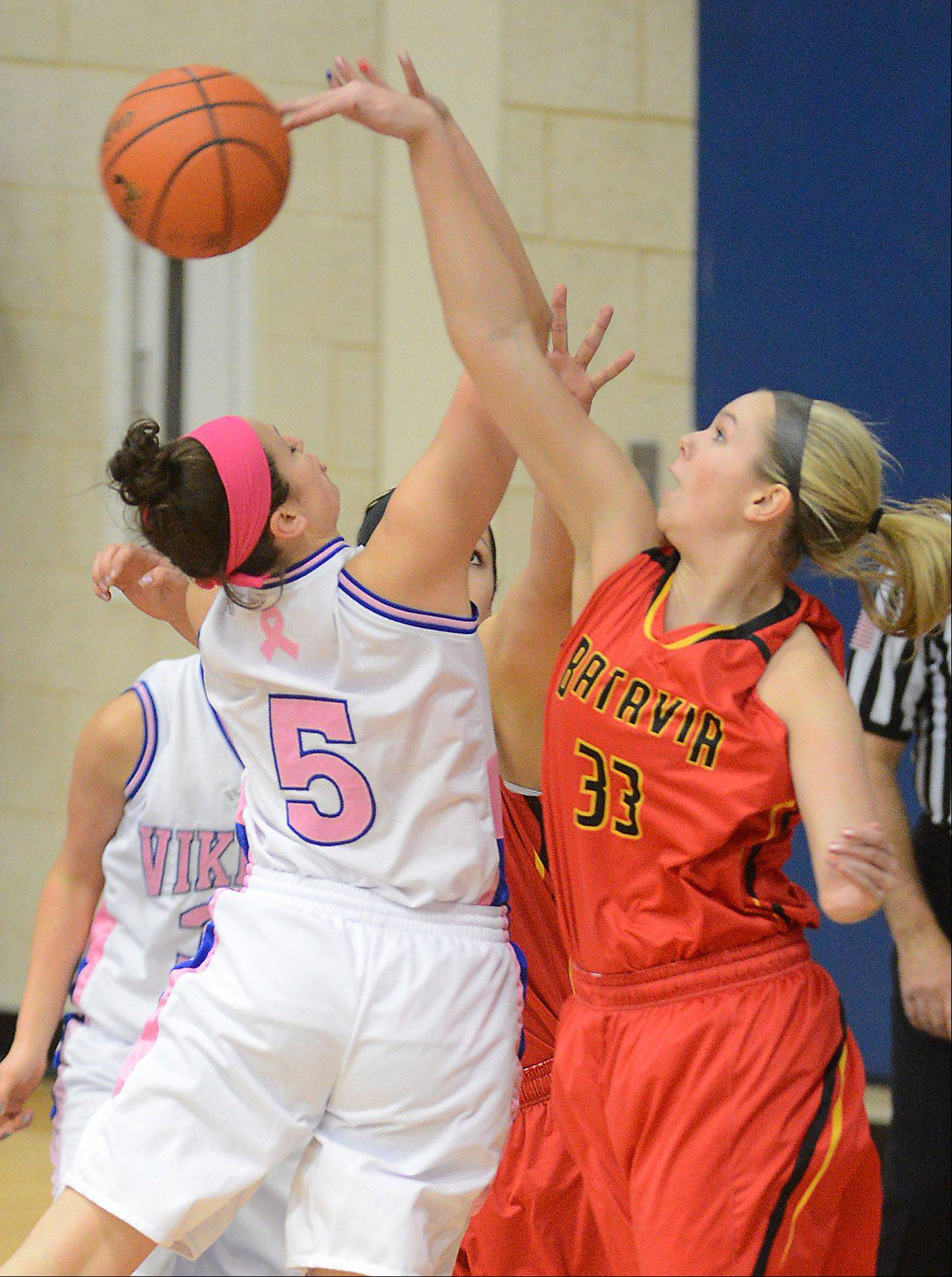 Batavia's Erin Bayram (33) blocks a shot by Geneva's Abby Novak (5) during Friday's game in Geneva.