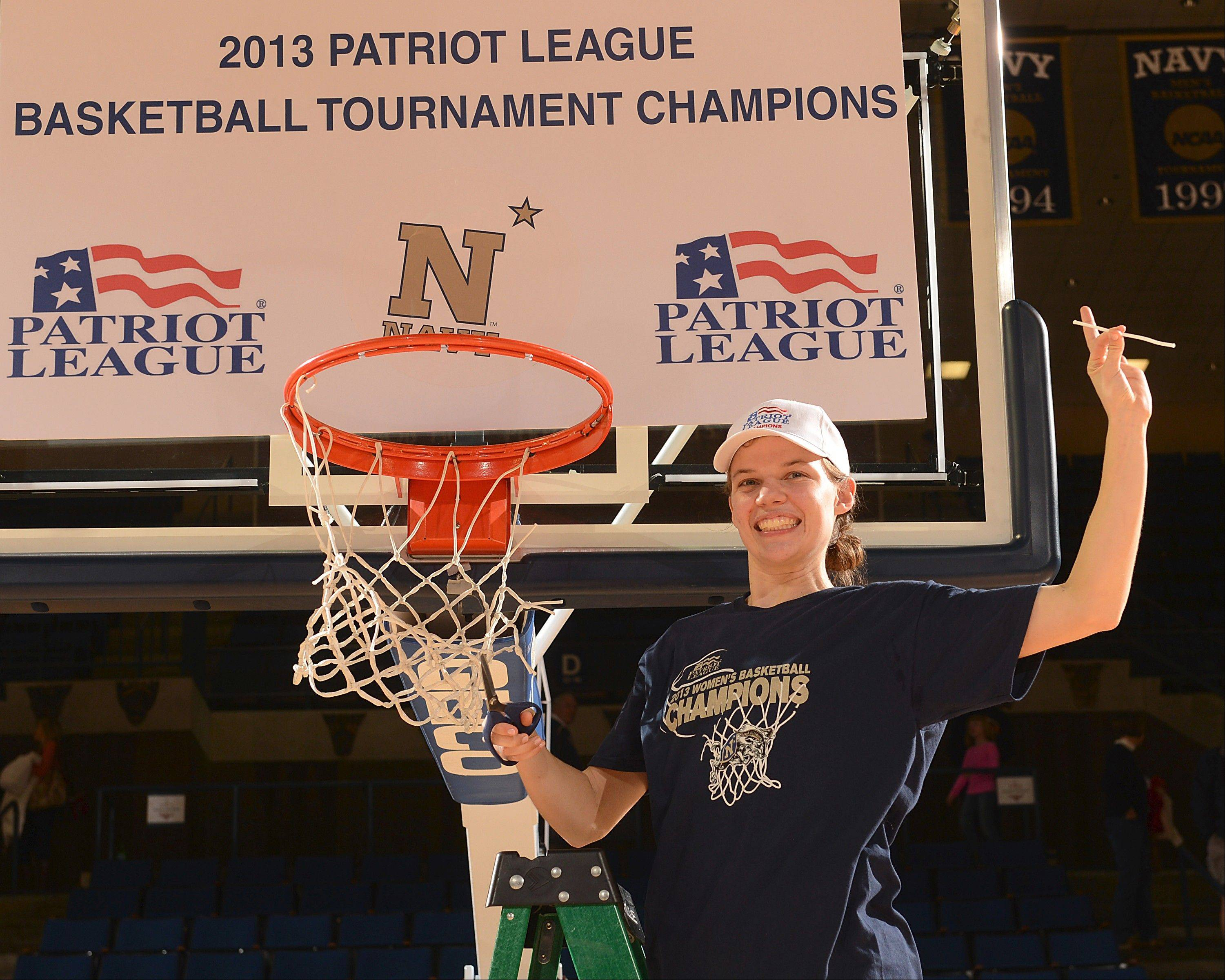 Former Lake Zurich basketball star Audrey Bauer celebrates after helping her Navy team win the Patriot League tourament last season. They are favored to repeat this season.