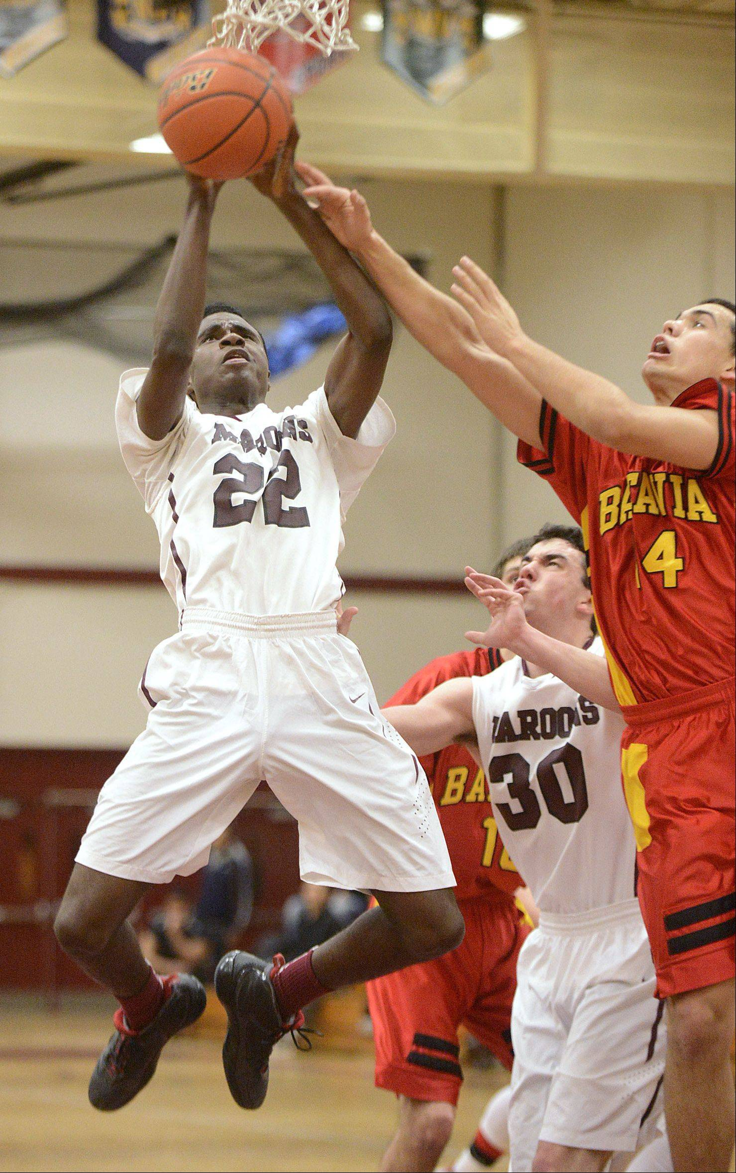 Elgin's Desmond Sanders sinks a shot around Batavia's Micah Coffey in the third quarter on Saturday, January 18.