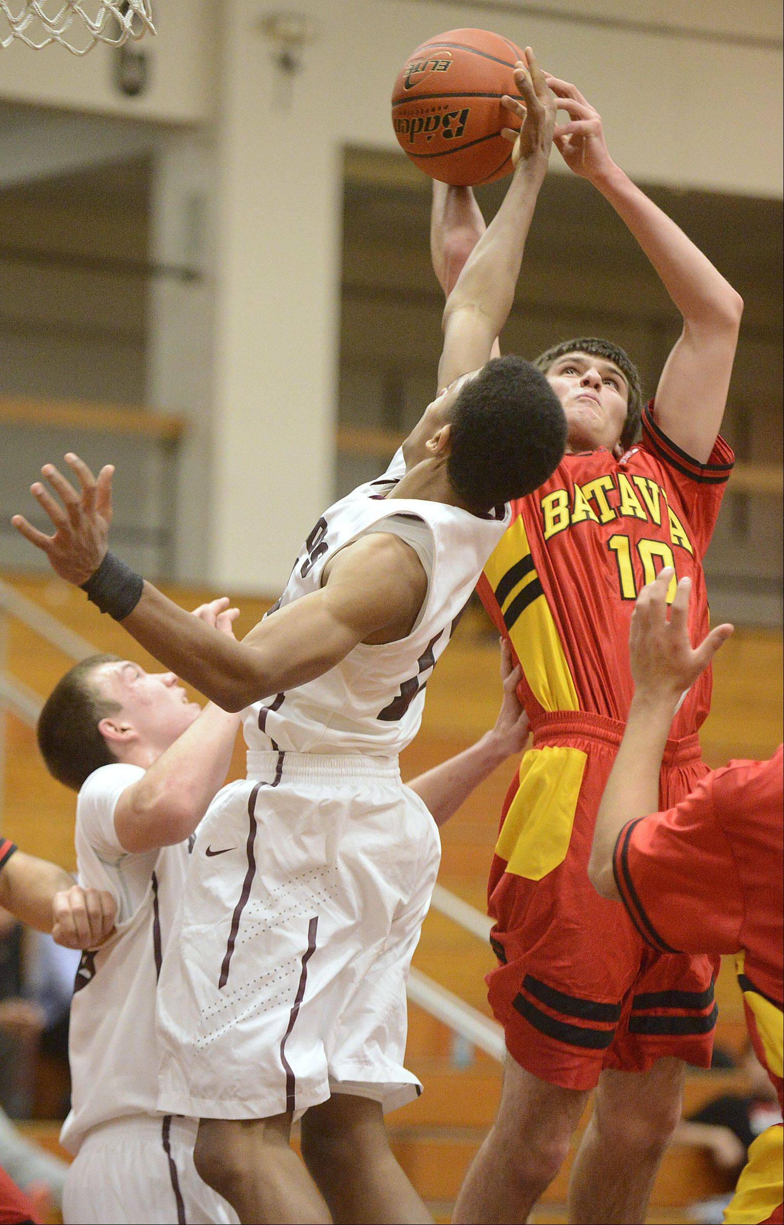 Batavia's Danny Pieczynski denies Elgin's Donte Harper a basket in the second quarter on Saturday, January 18.