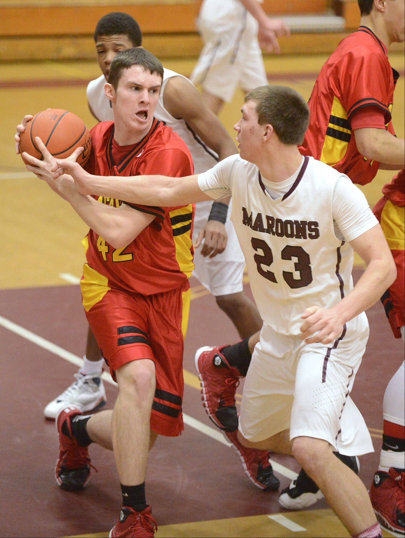 Batavia's Ryan Olson hangs on tight to a rebound near Elgin's Ryan Sitter in the second quarter on Saturday, January 18.