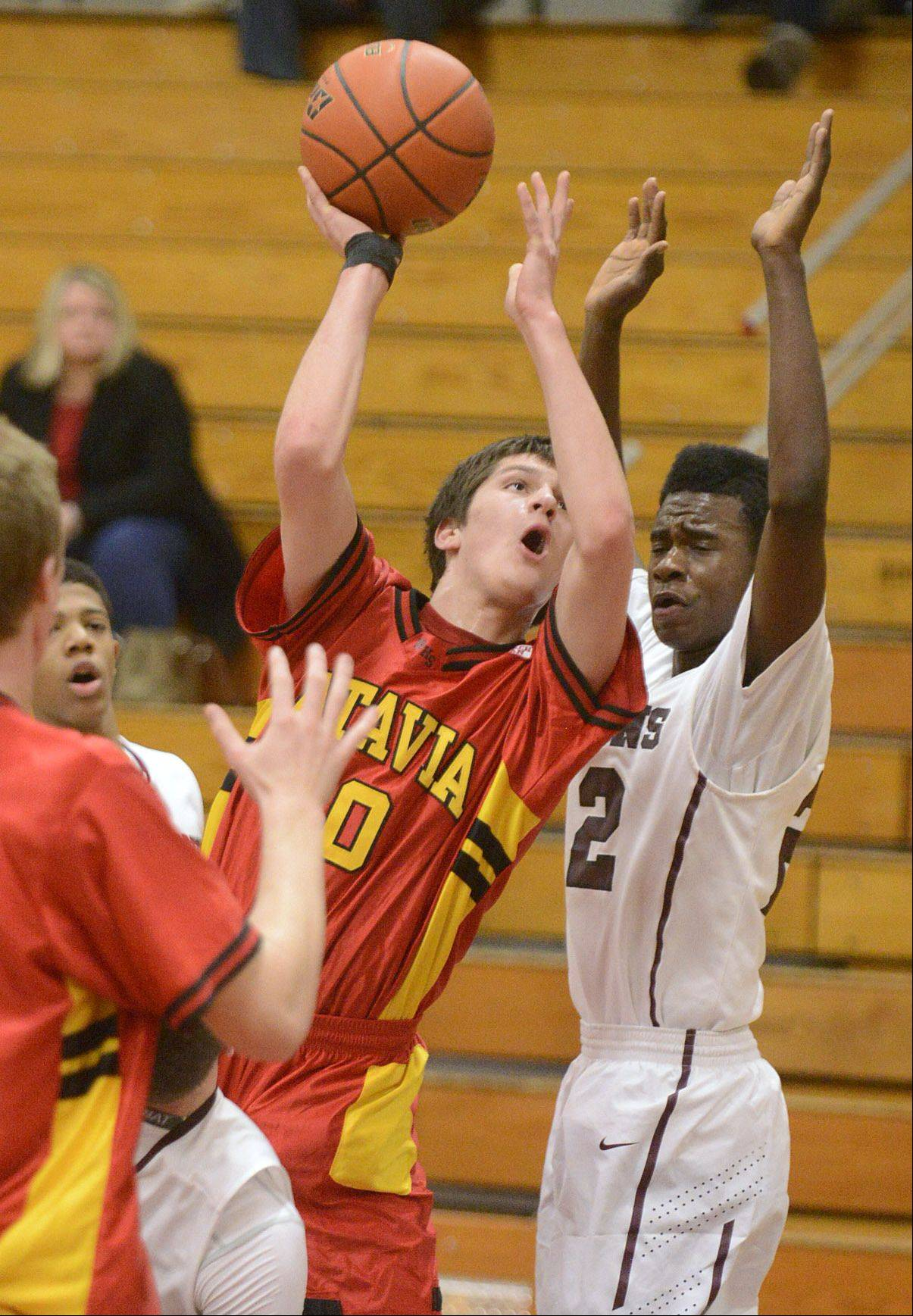 Batavia's Danny Pieczynski shoots past Elgin's Desmond Sanders in the first quarter on Saturday, January 18.