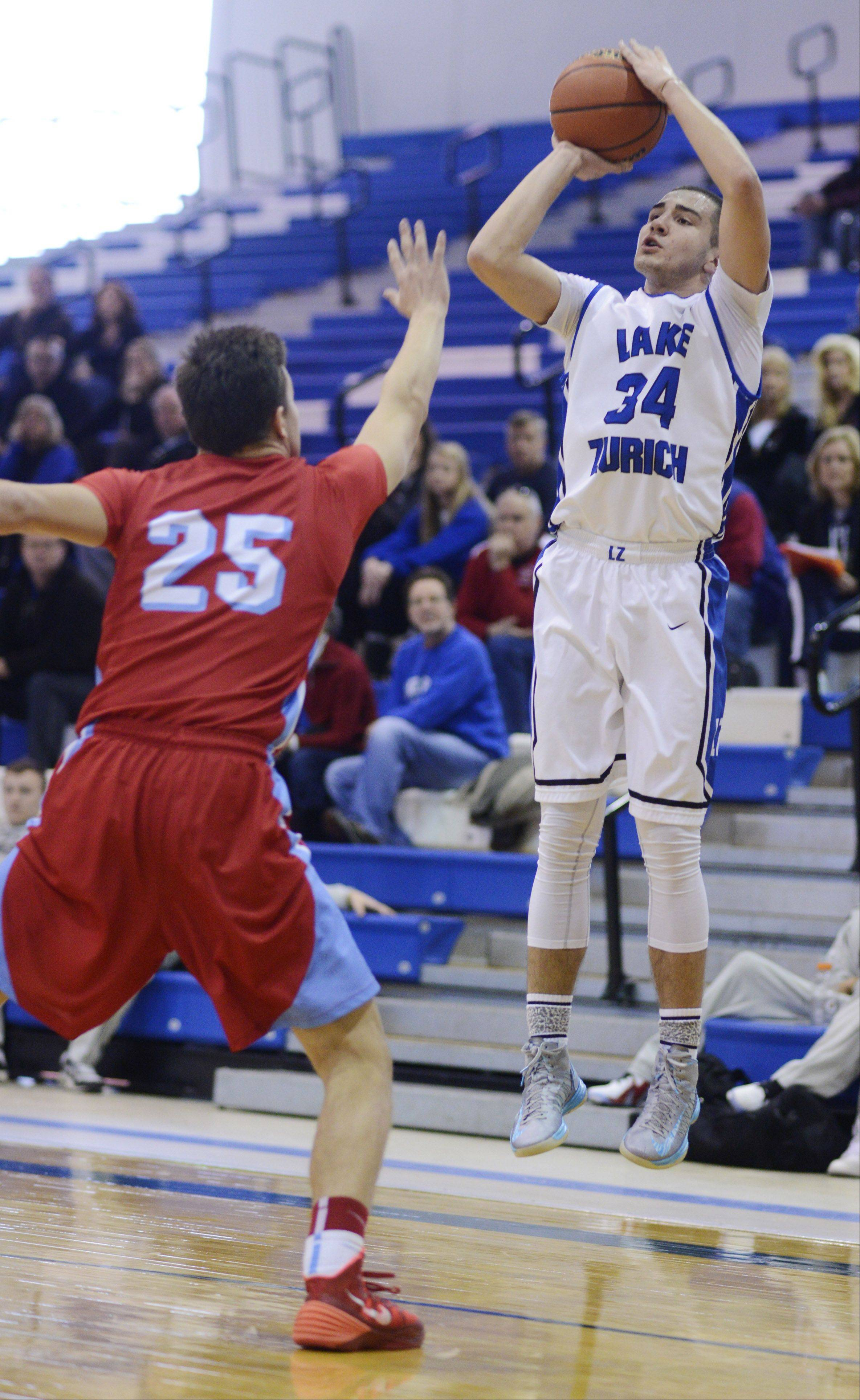 Lake Zurich's Mike Travlos, right, shoots a jump shot in front of Marian Central defender Nate Patterson during the Martin Luther King Classic at Lake Zurich Saturday.