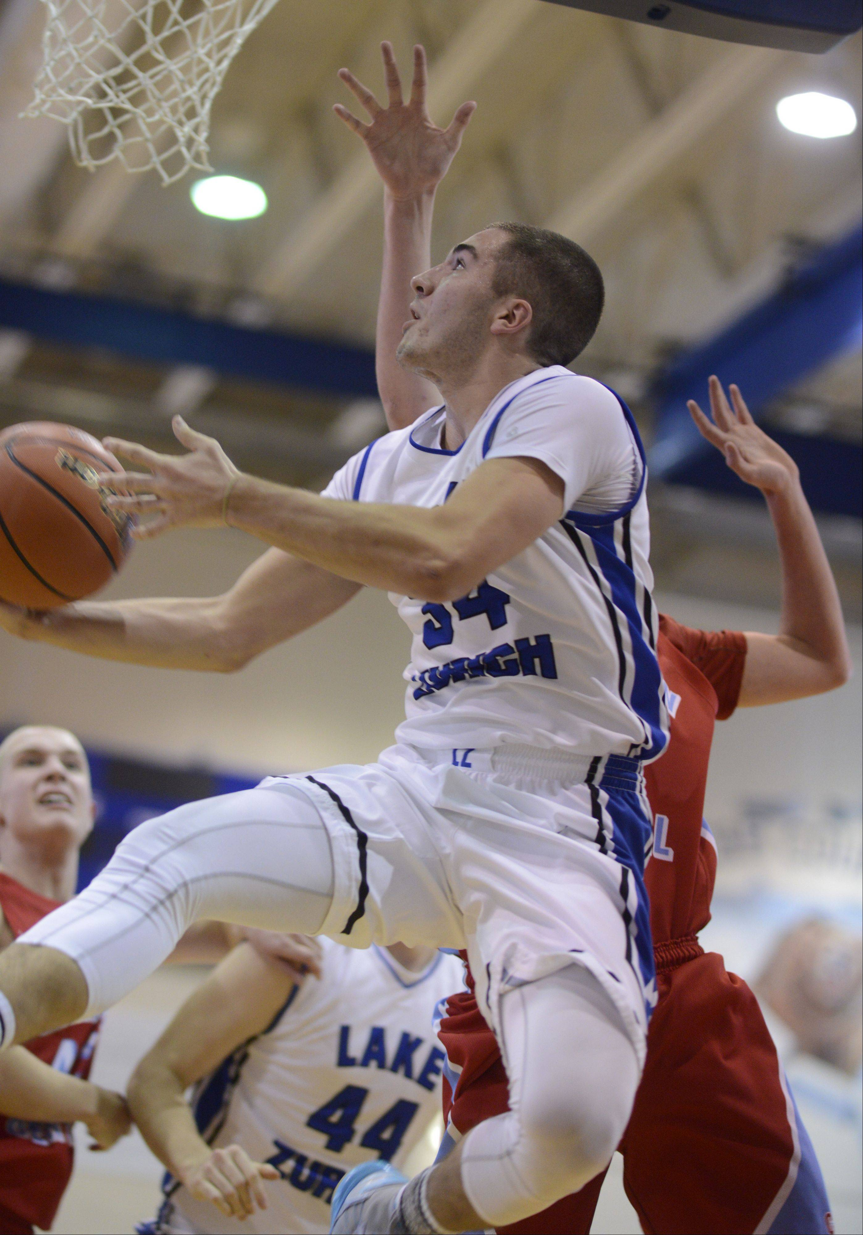 Images from the Marian Central at Lake Zurich boys basketball game on Saturday, January 18.