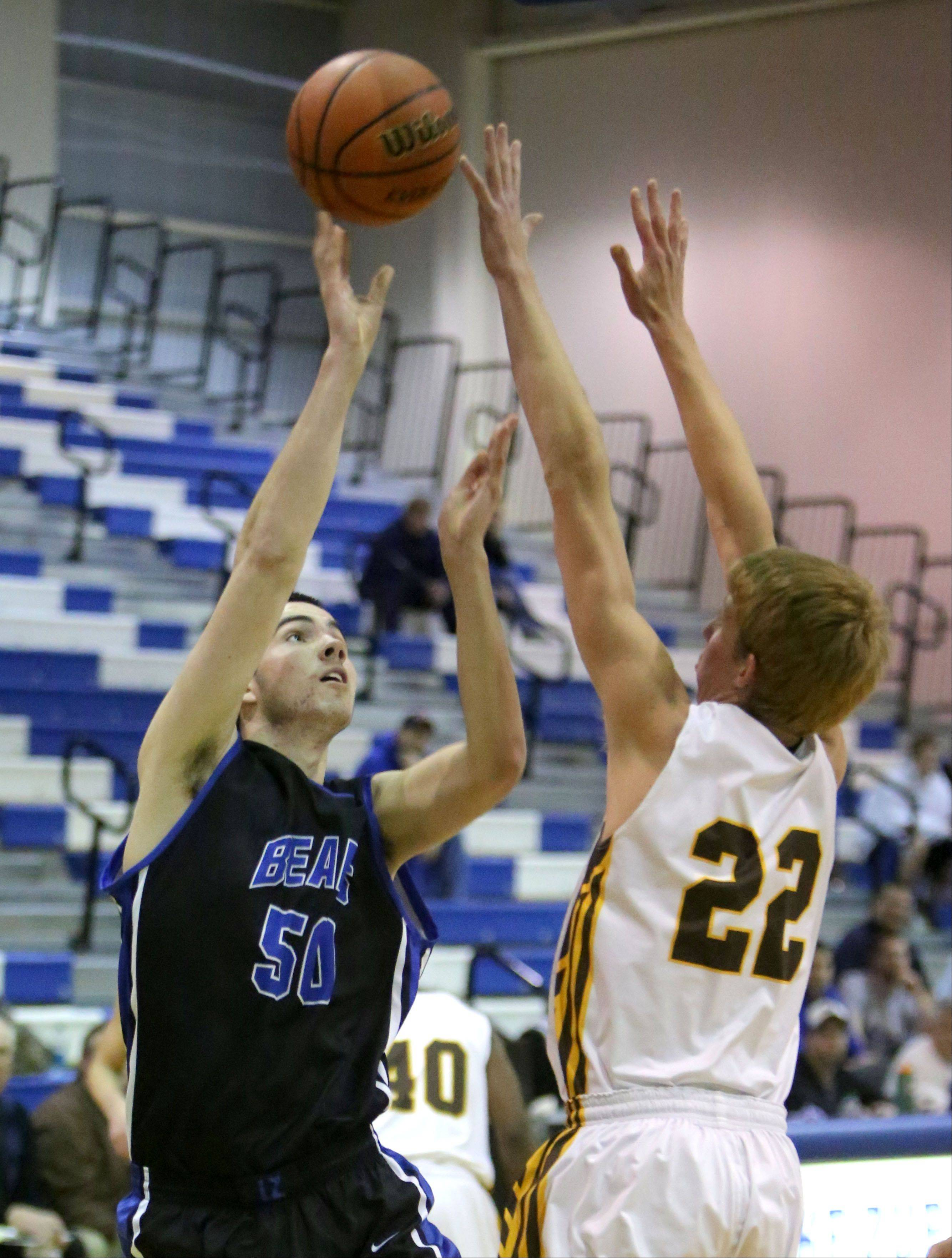 Lake Zurich's Will McClaughry, left, shoots over Carmel's Michael Barr at Lake Zurich on Monday.
