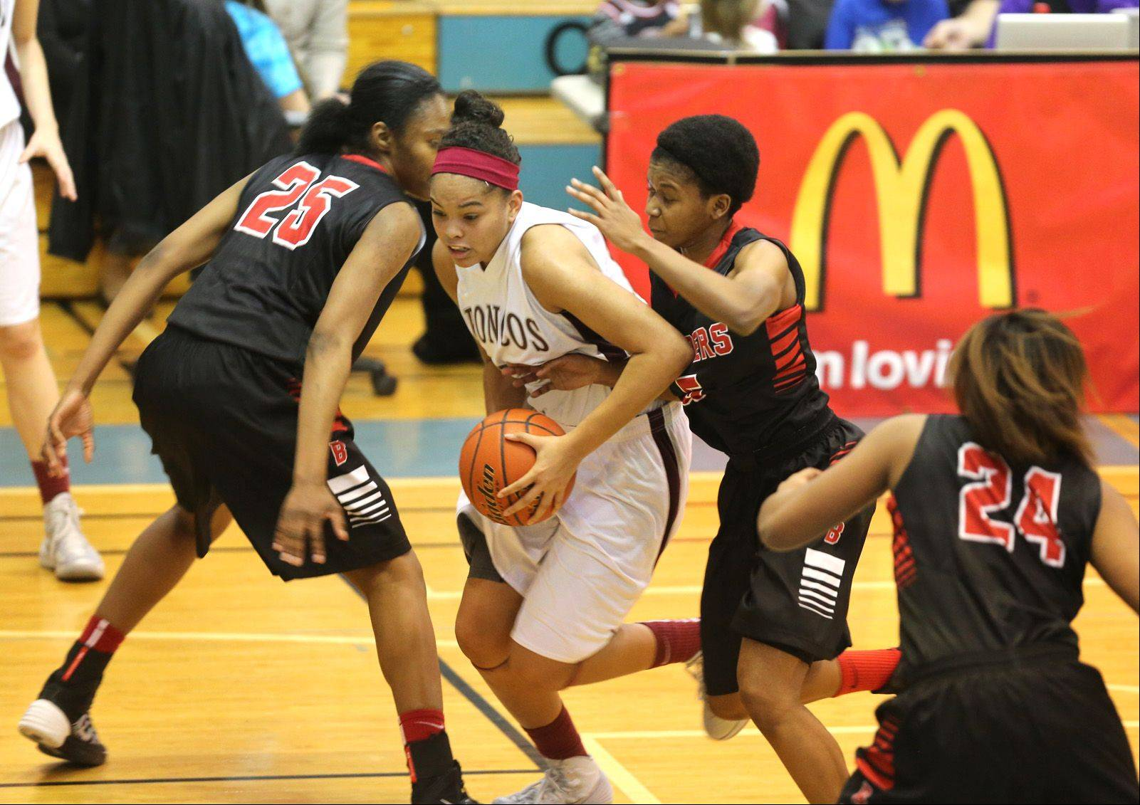 Montini battles Bolingbrook during the 24th annual McDonald's Shootout, a girls basketball tournament at Willowbrook High School.