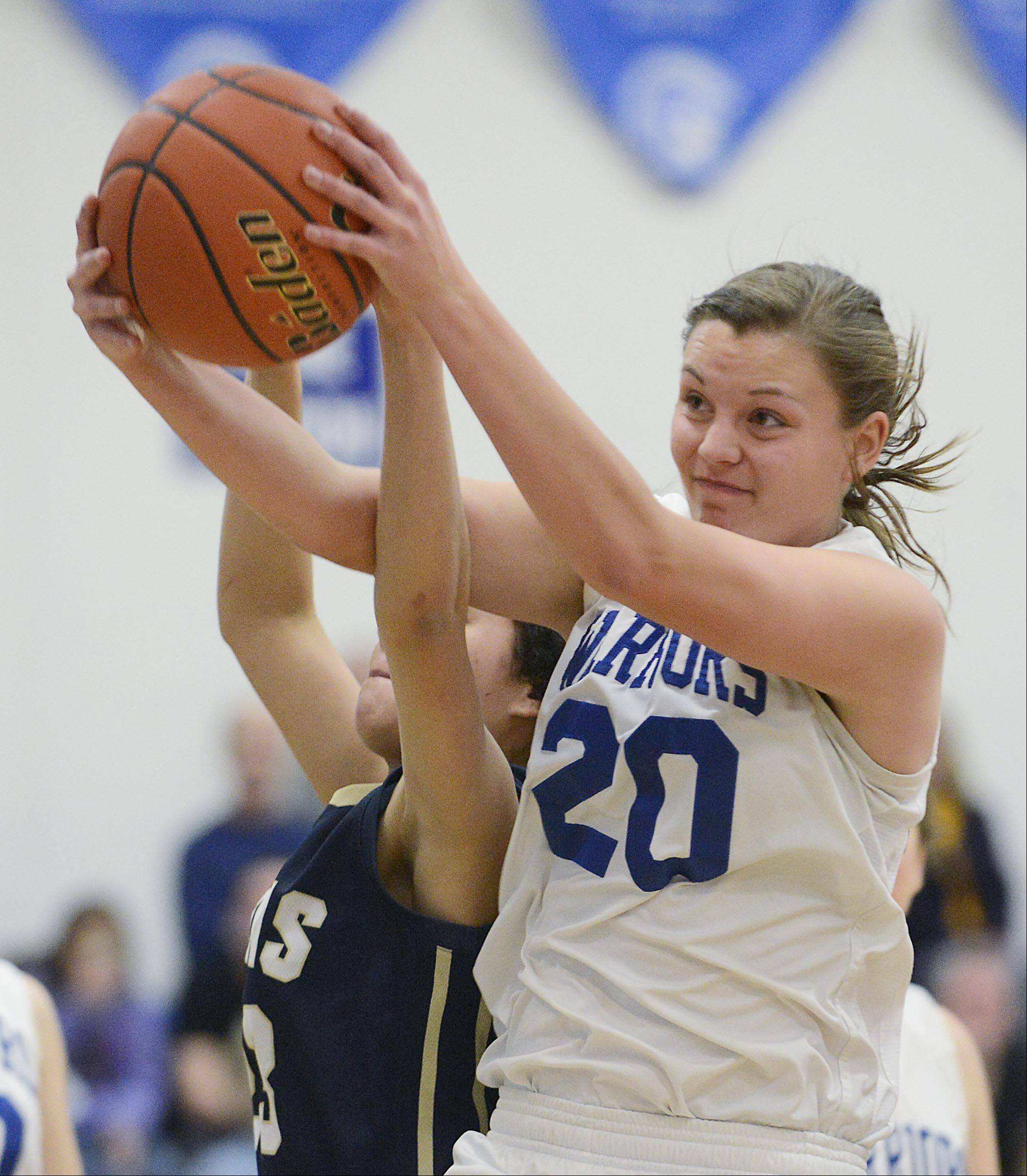 John Starks/jstarks@dailyherald.comWestminster Christian's Claire Speweik gets to a rebound before Harvest Christian's Gabi Rodriguez Monday in Elgin.