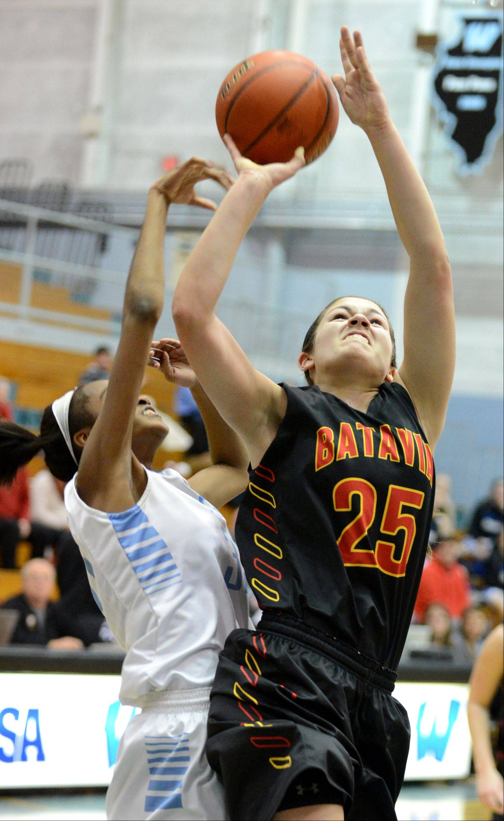 Batavia's Hannah Frazier goes up for a shot against Joliet Catholic's Ty Battle defending during Monday's game at the 24th annual McDonald's Shootout at Willowbrook High School in Villa Park.