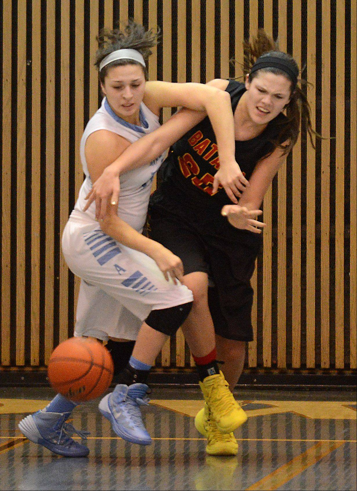 Joliet Catholic's Andriana Acosta and Batavia's Hannah Frazier battle for a loose ball during Monday's game at the 24th annual McDonald's Shootout at Willowbrook High School in Villa Park.