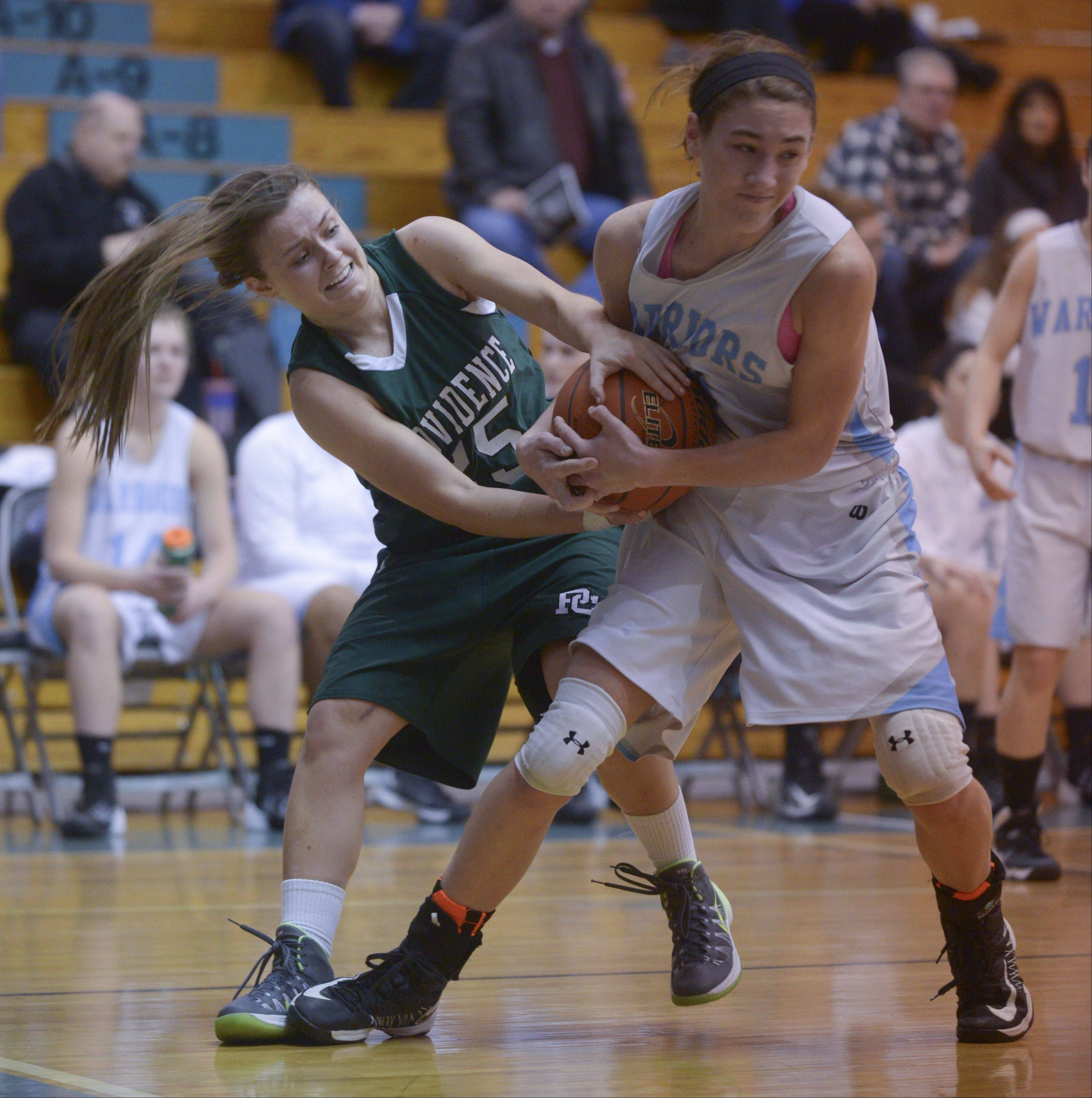 Providence's Anne Corso and Willowbrook's Molly Krawczykowski battle for control of the ball during the McDonald's girls basketball shootout at Willowbrook High School.