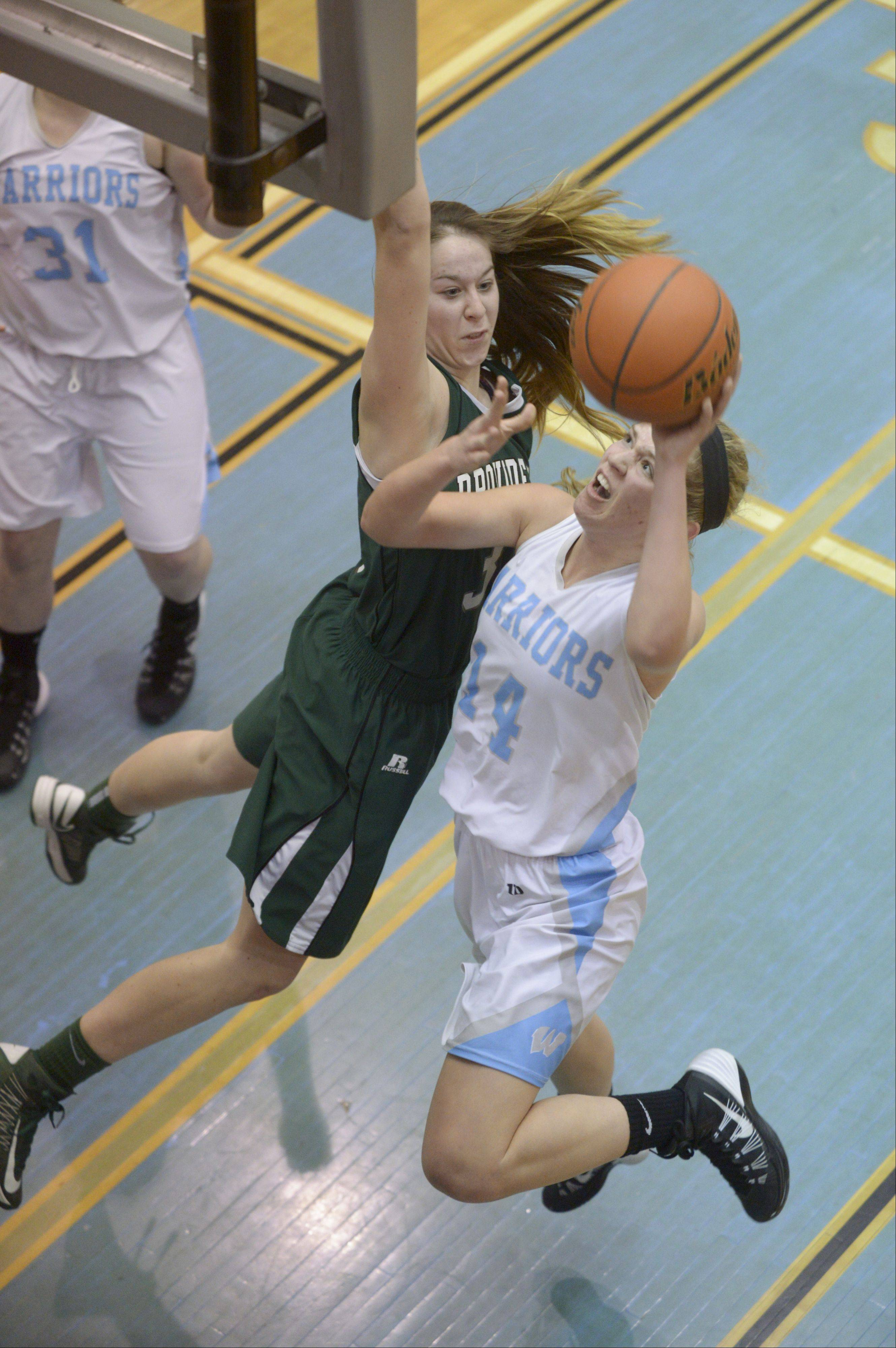 Willowbrook's Lauren Carroll lays up for a shot getting past Providence's Maeve Garvey during the McDonald's girls basketball shootout at Willowbrook High School.