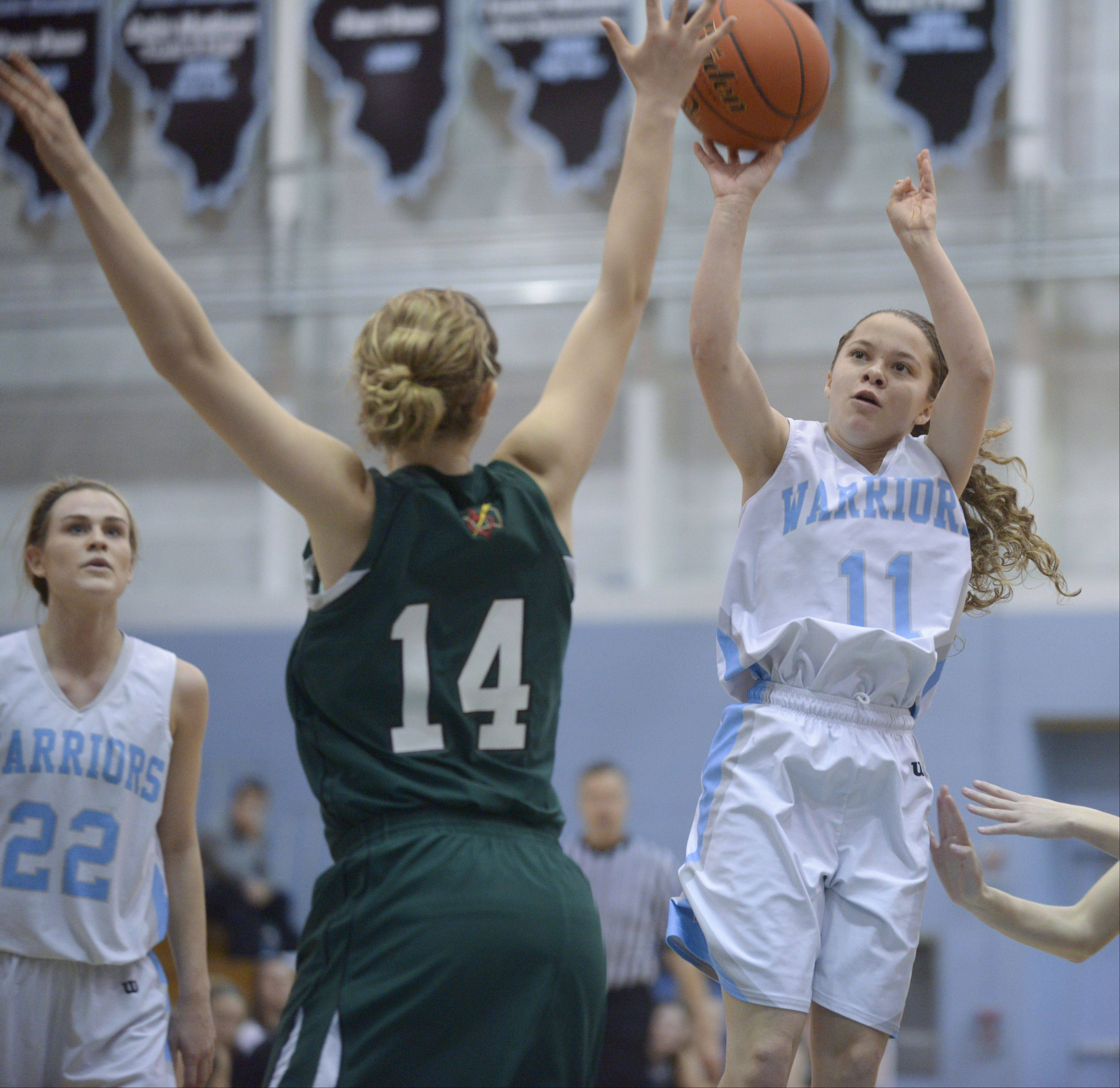 Willowbrook's Danielle Velasquez takes a shot over Providence's Taylor Juricek during the McDonald's girls basketball shootout at Willowbrook High School.
