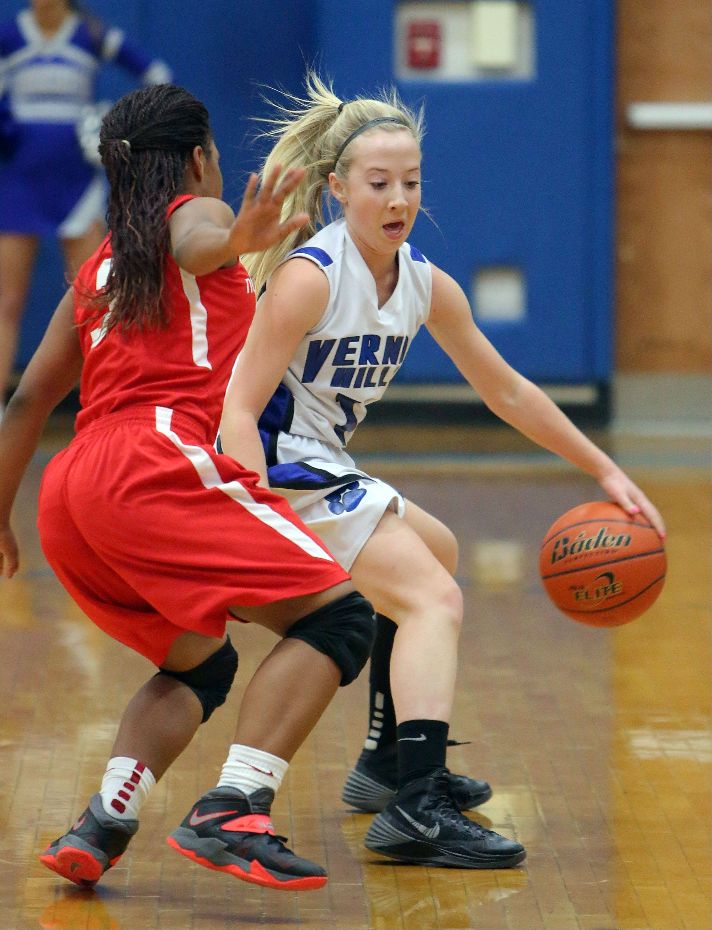 Vernon Hills' Haley Lieberman, right, drives on North Chicago's Alexis Means on Wednesday at Vernon Hills.