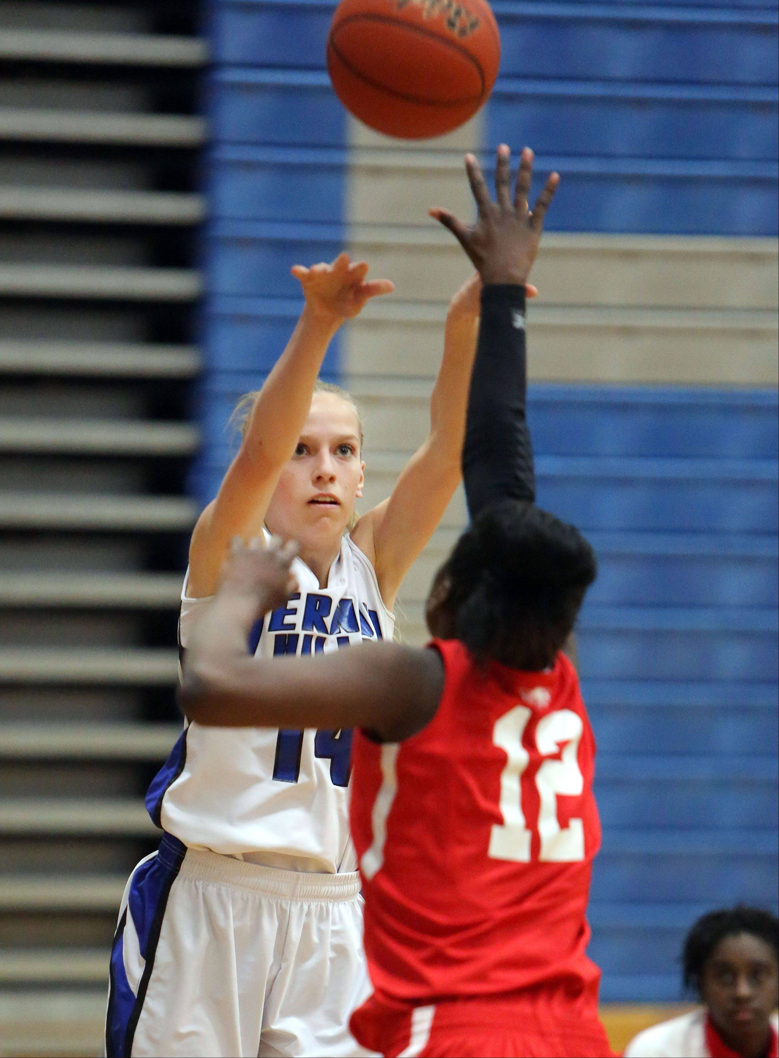 Vernon Hills' Kasey Firnbach, left, shoots over North Chicago's Kaylah Collins on Wednesday at Vernon Hills.