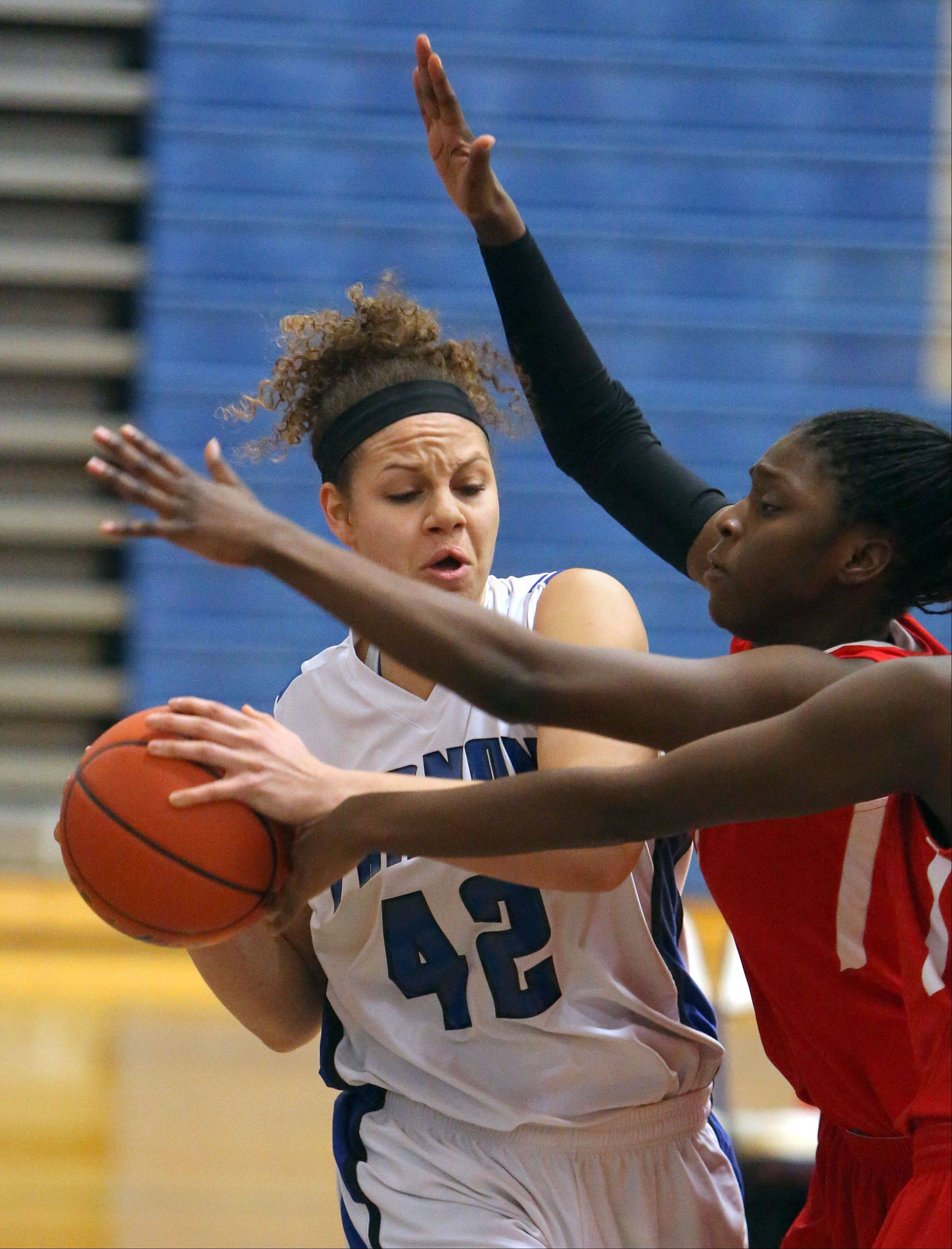 Vernon Hills' Lauren Webb gets trapped by North Chicago defenders Wednesday at Vernon Hills.