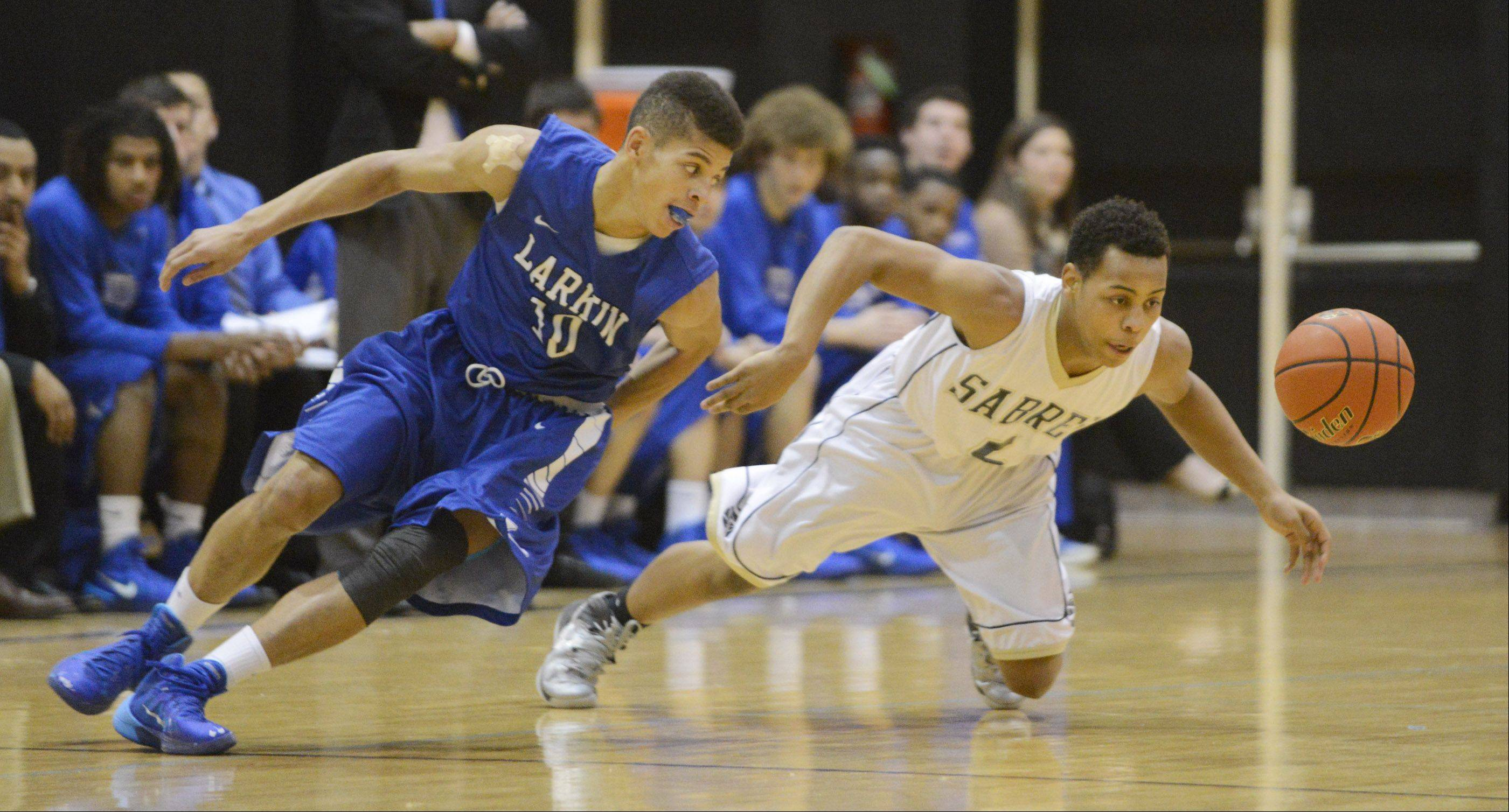 Streamwood's Kiantae Allen and Larkin's Kendale McCullum turn for a loose ball Wednesday in Streamwood.